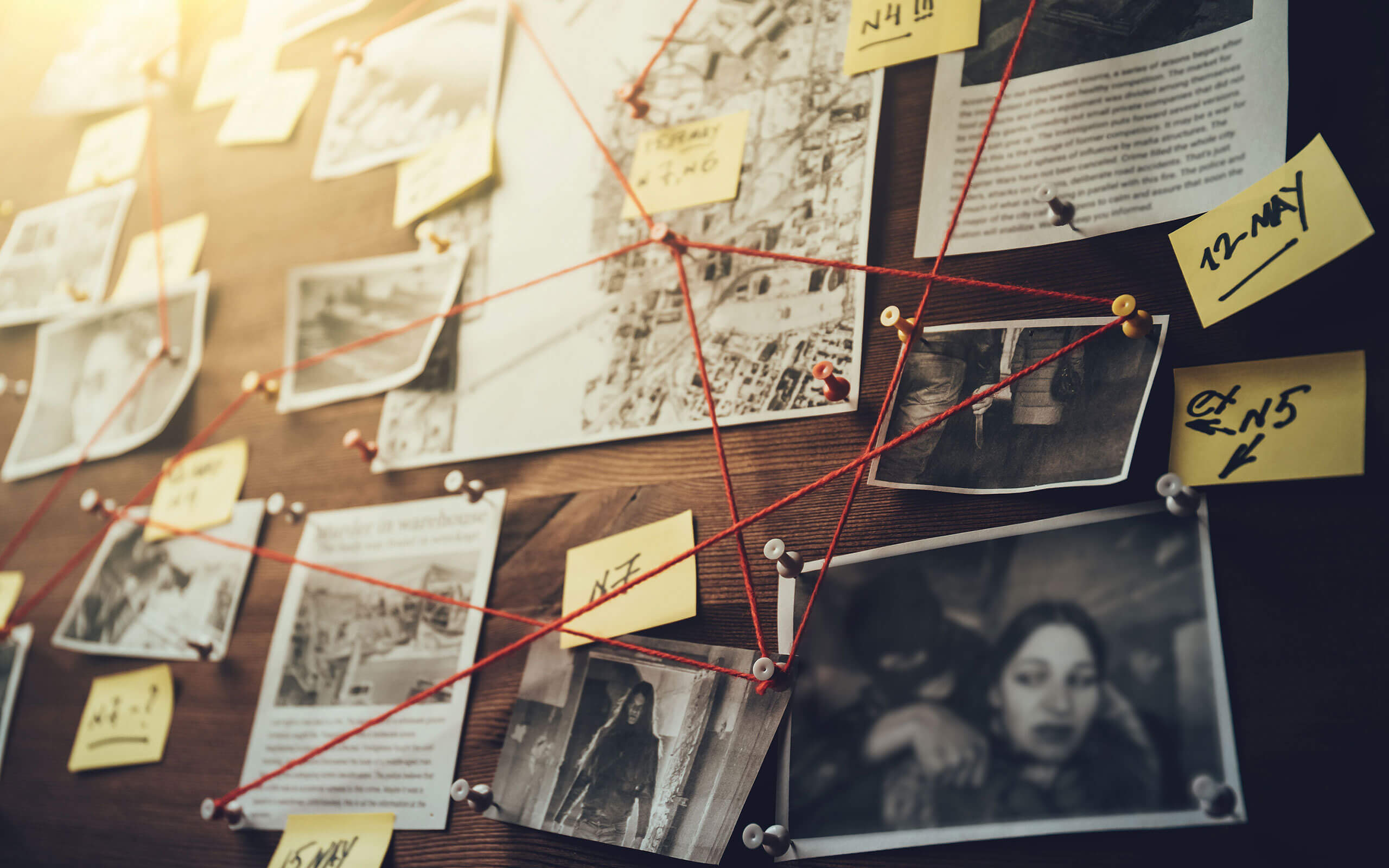 Crime investigation board with red string linking photos and post-its