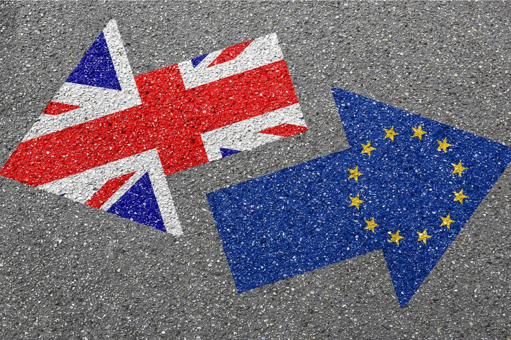 Image of UK flag and EU flag in arrows going the opposite way.