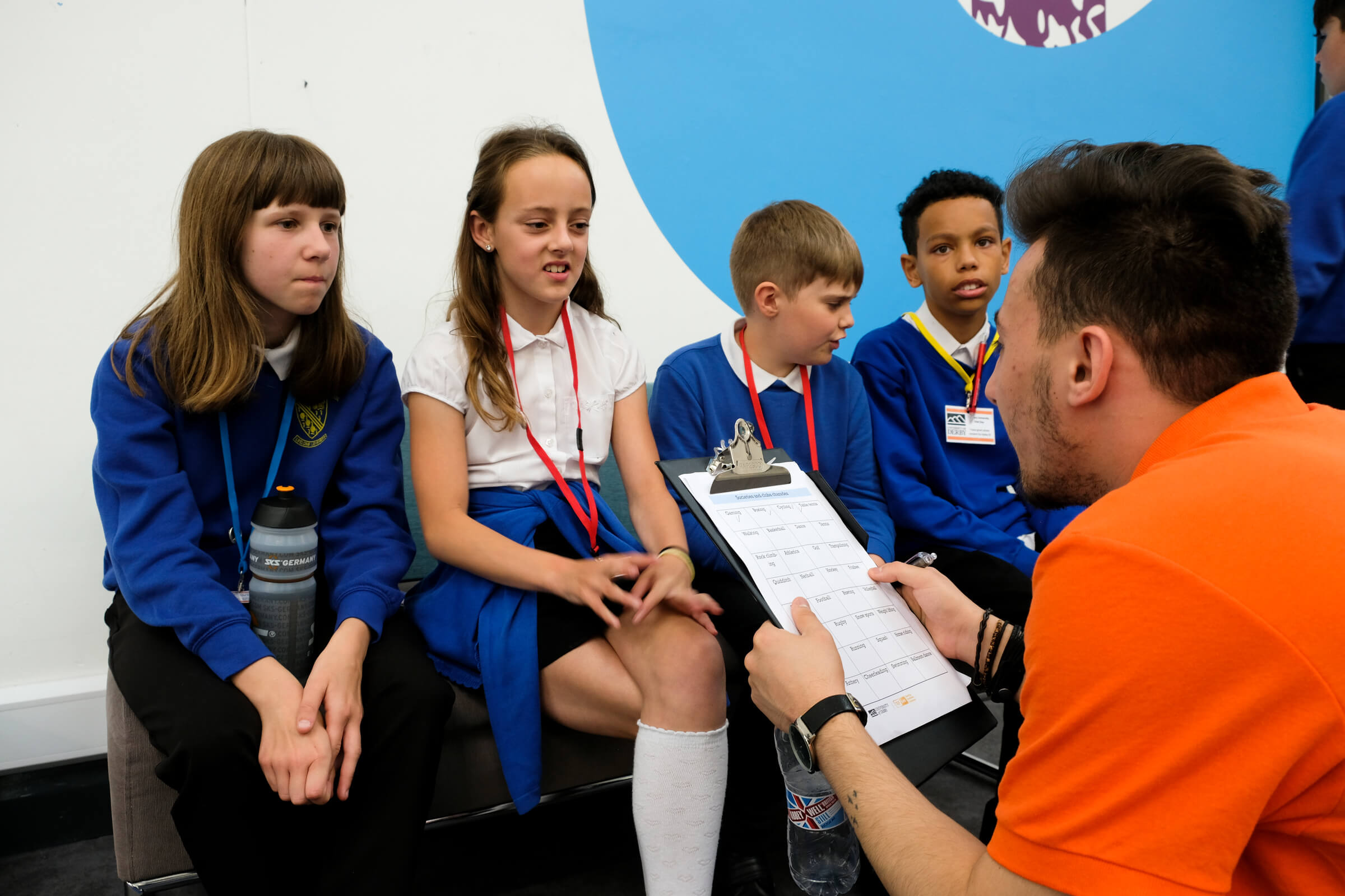 A student ambassador working with primary school students during a school visit day