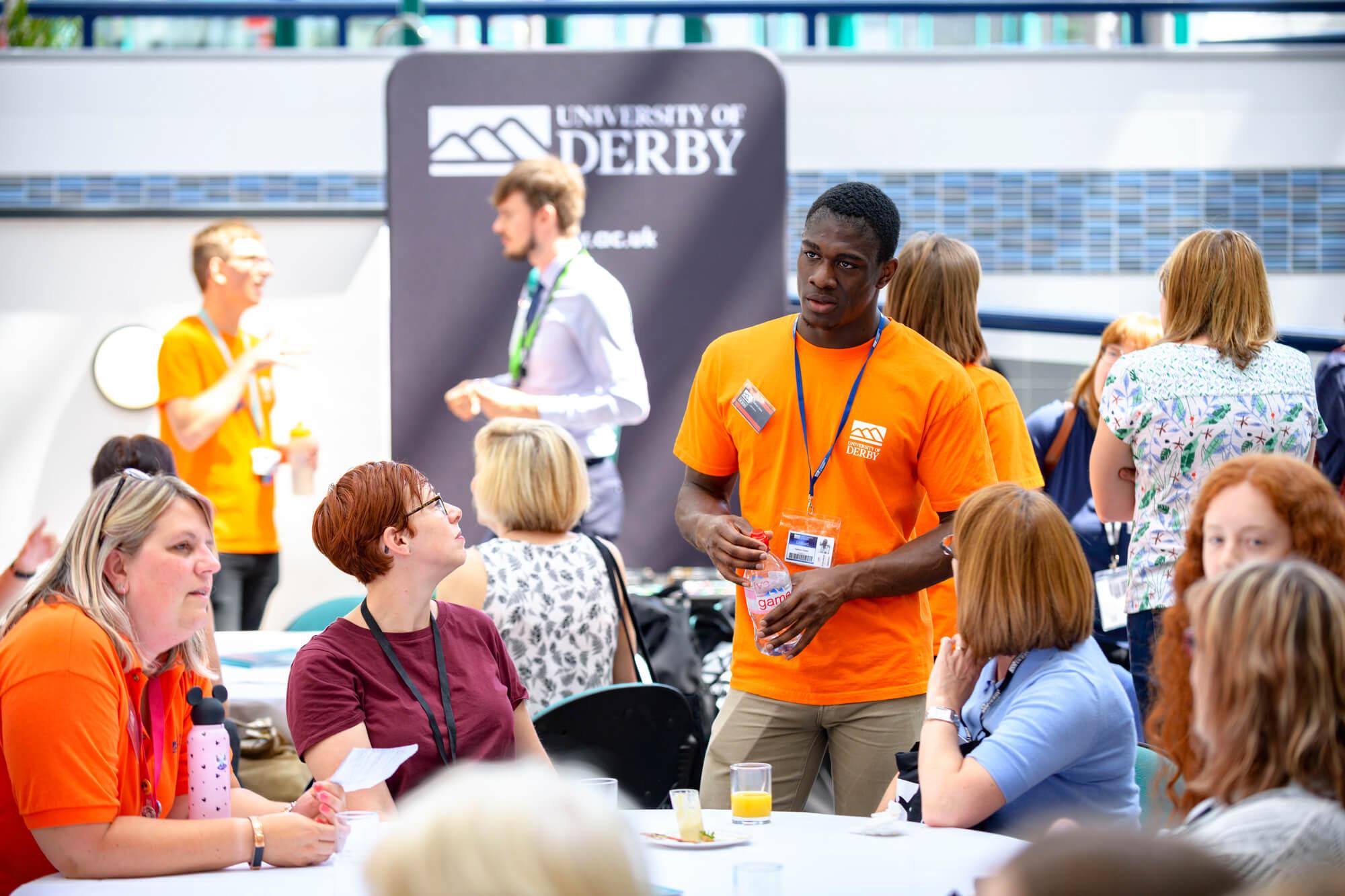 Student ambassador speaking with delegates at the 2019 progression conference