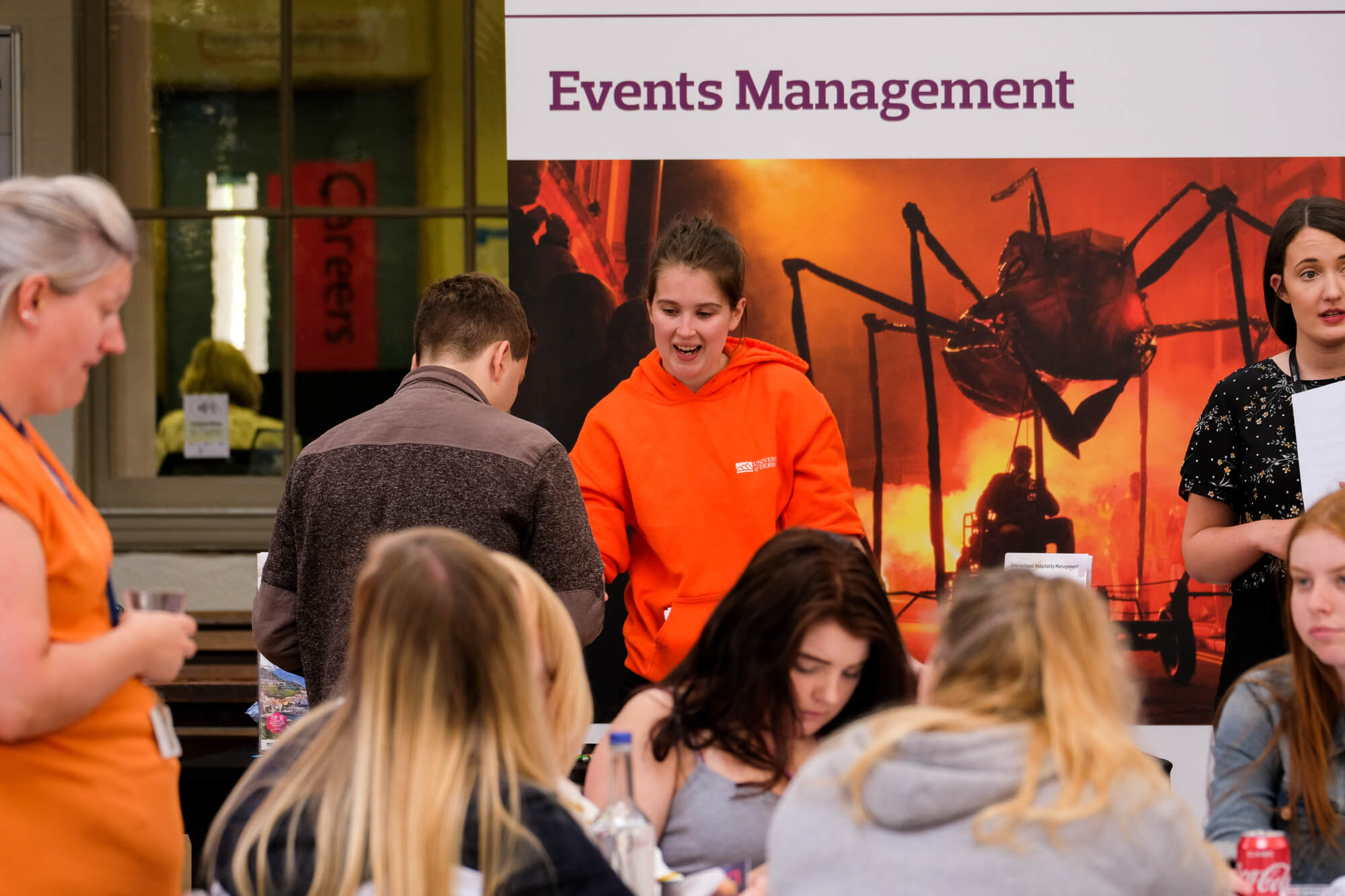 Student Ambassador answering a question that a prospective student has during a Buxton event