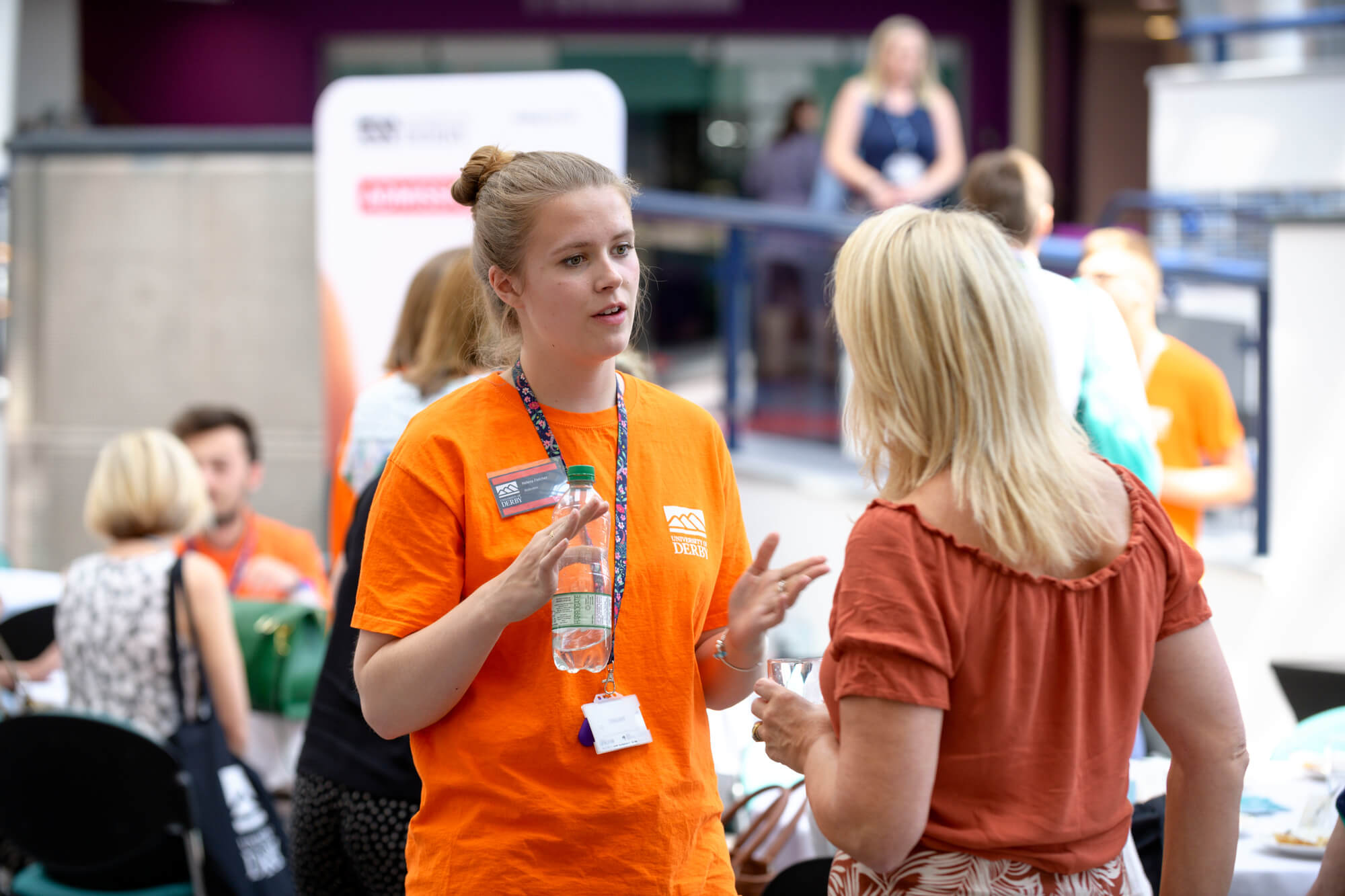 Student Ambassador speaking with a delegate at the 2019 progression conference