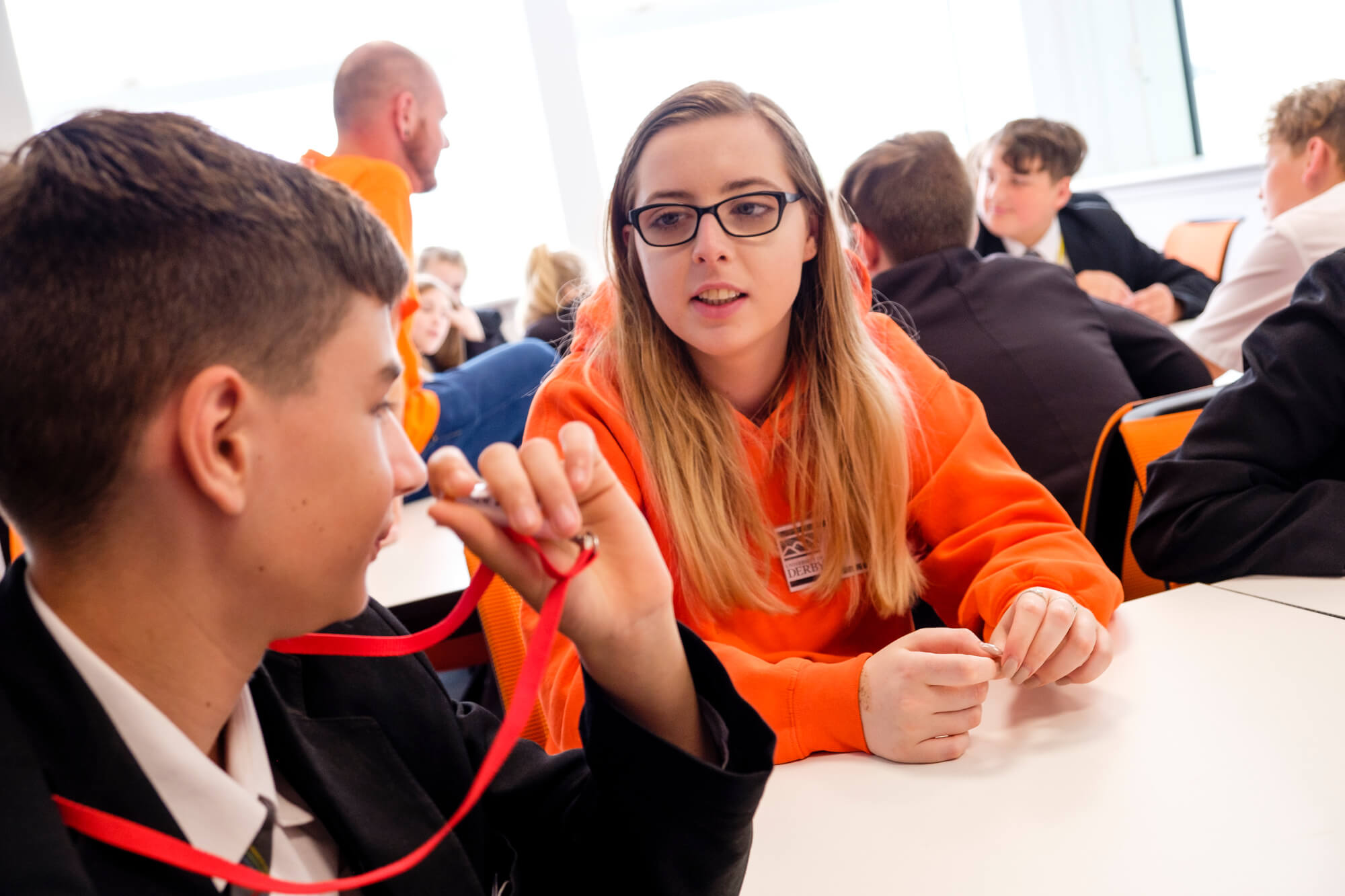 Student ambassador helping a year 7 student during an event