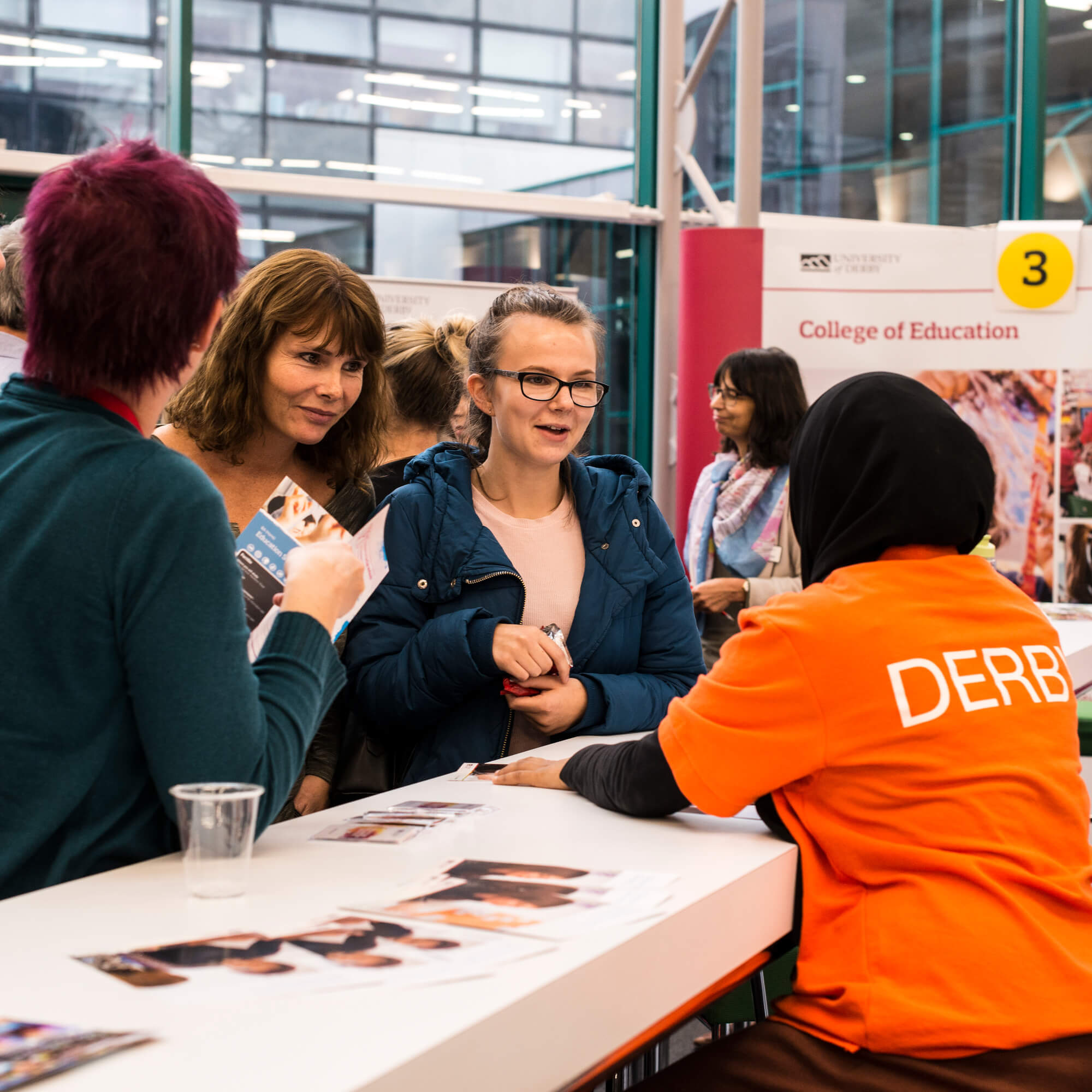 Ambassador assisting students on an Open Day at a College stand