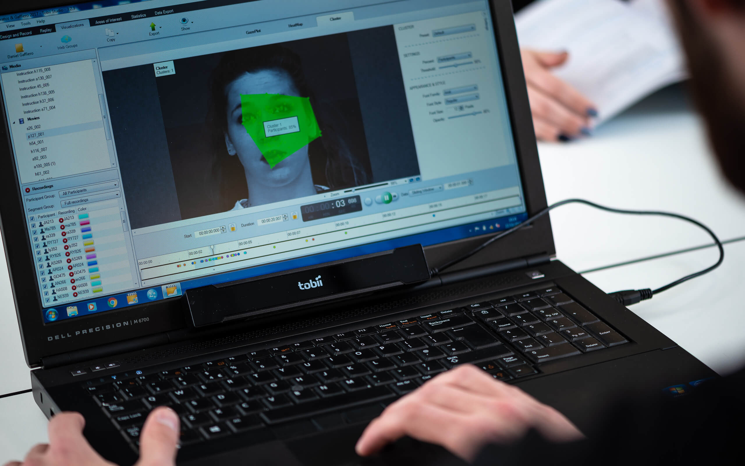 A student using psychological imaging software on a laptop