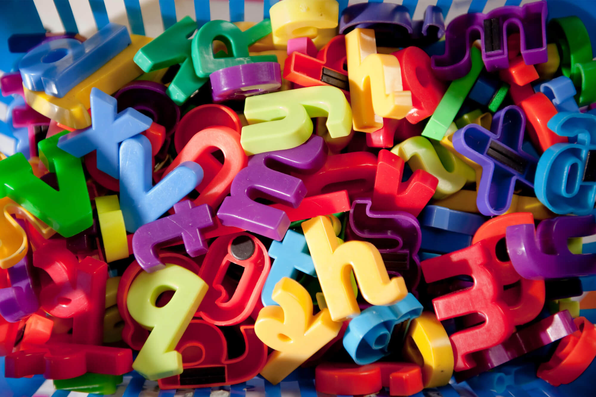 A basket of colourful plastic letters