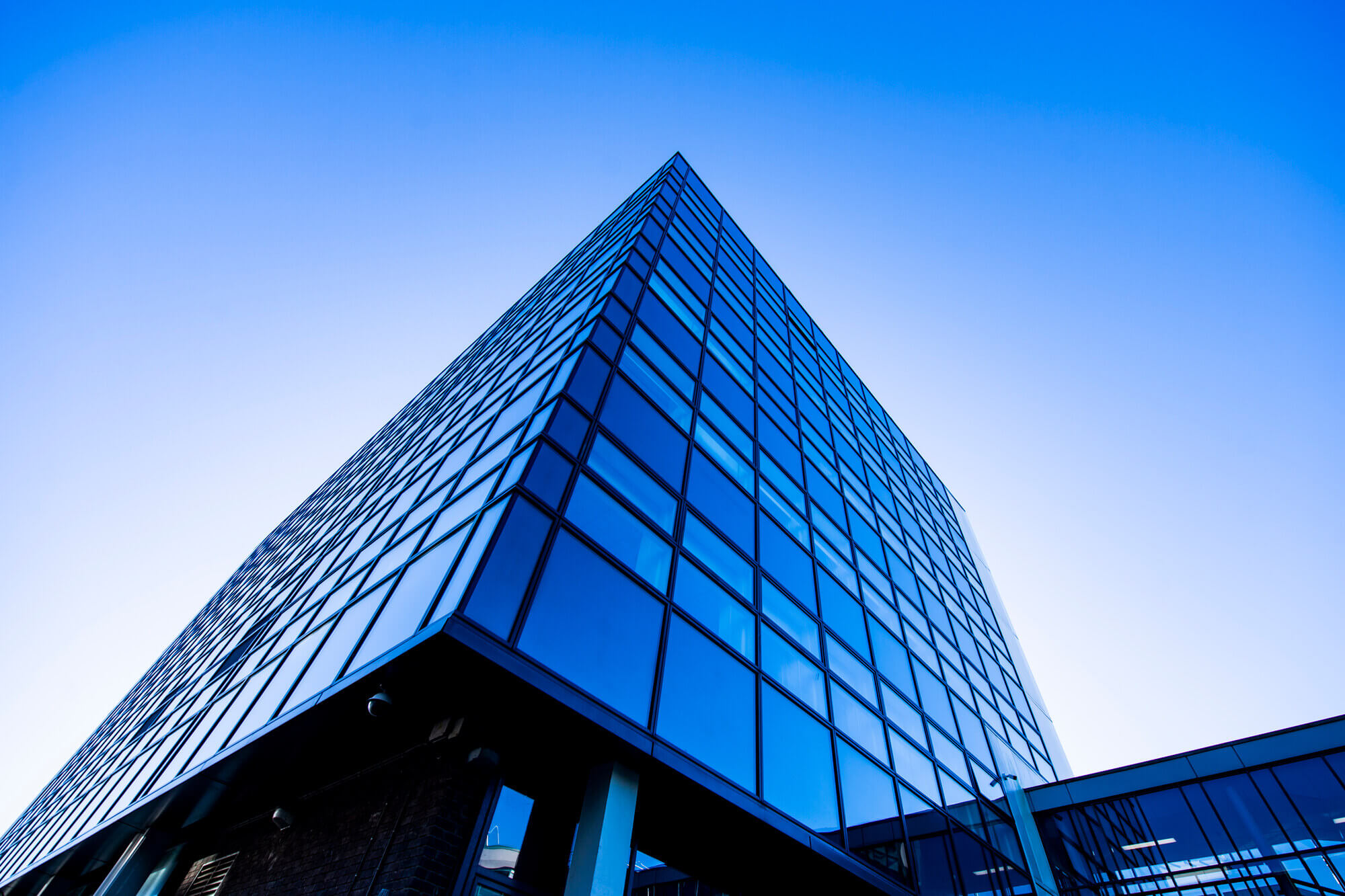 An image looking up to a blue building on our Kedleston Road site at the University