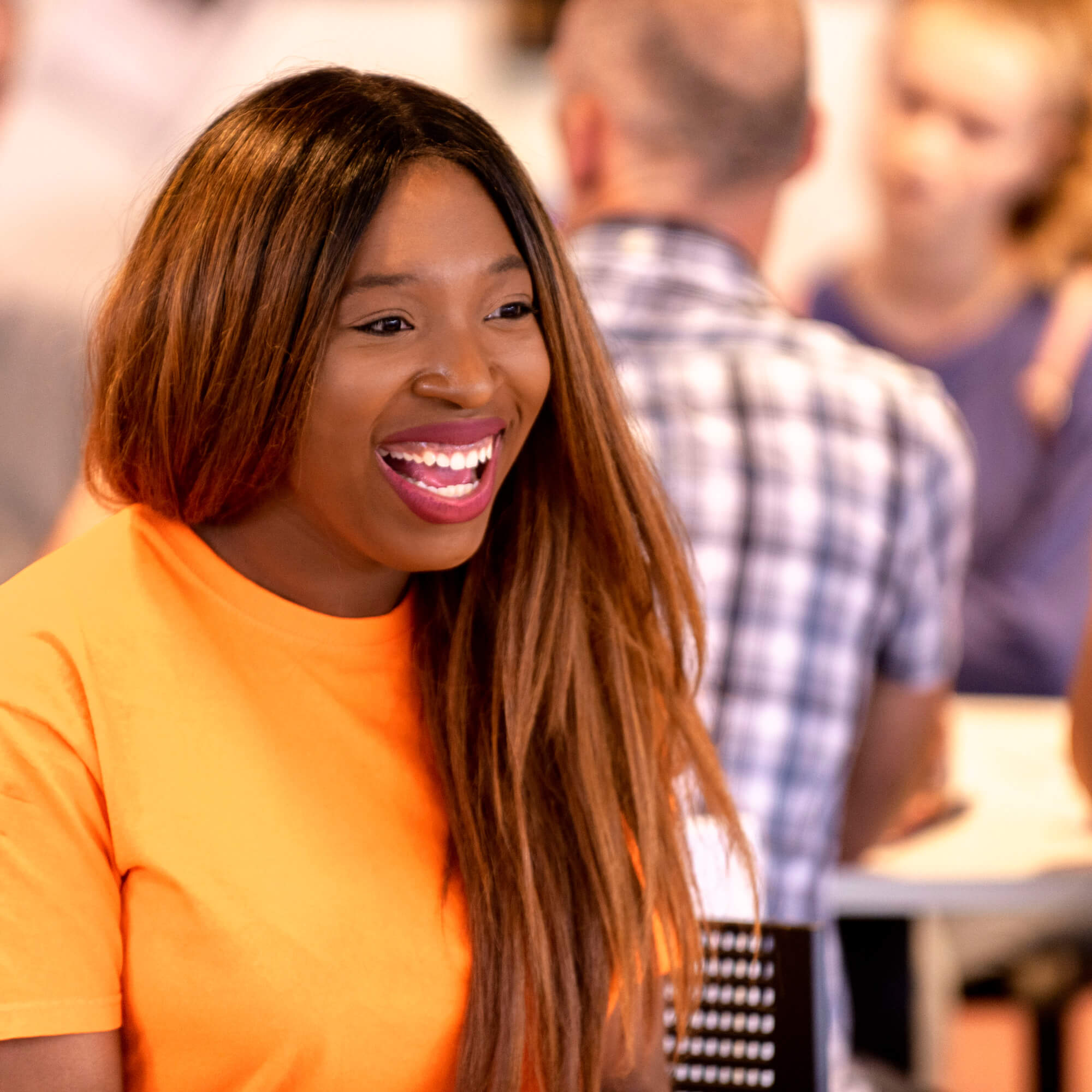 A female student smiling at an Open Day