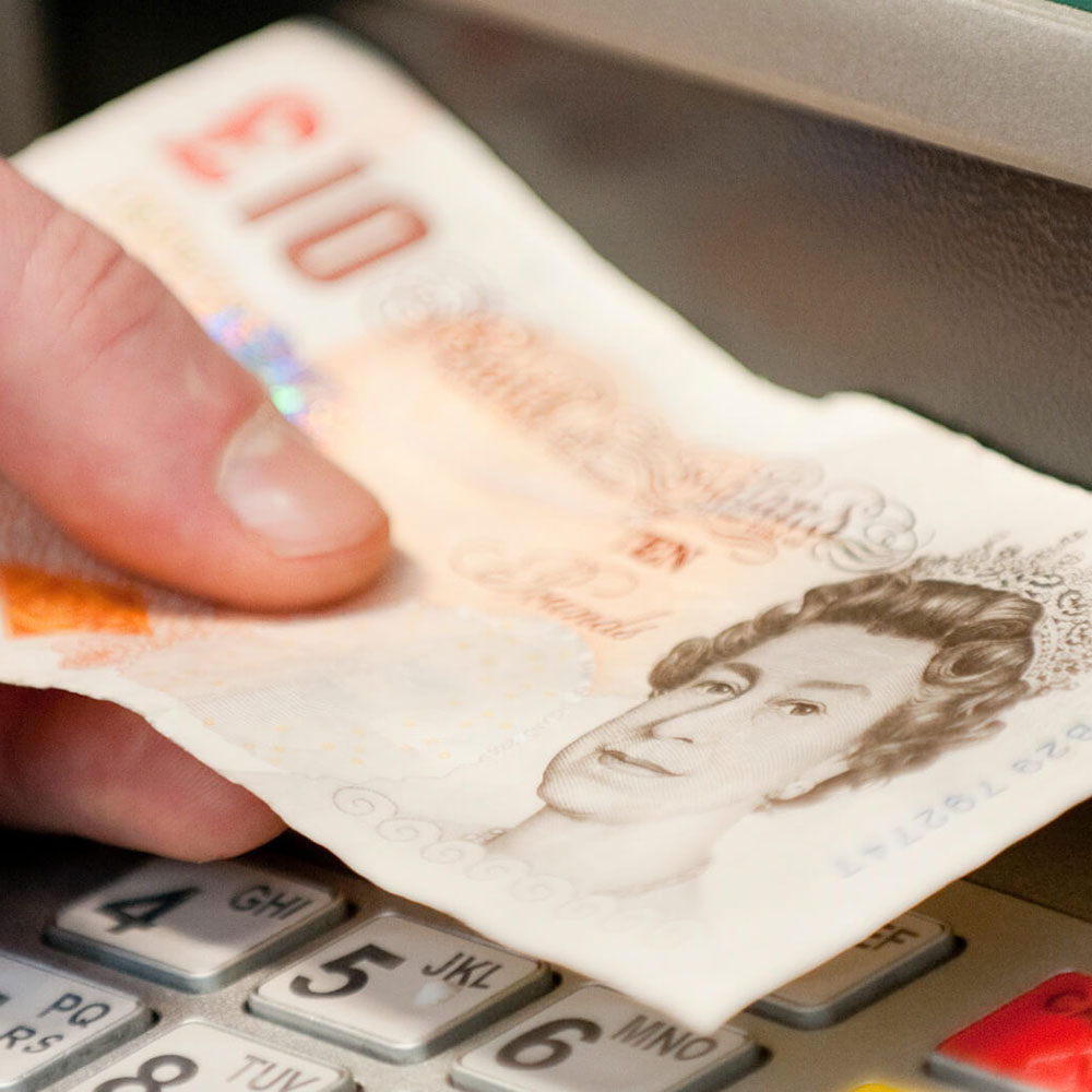 A student withdraws money from the on-site cash-point machine