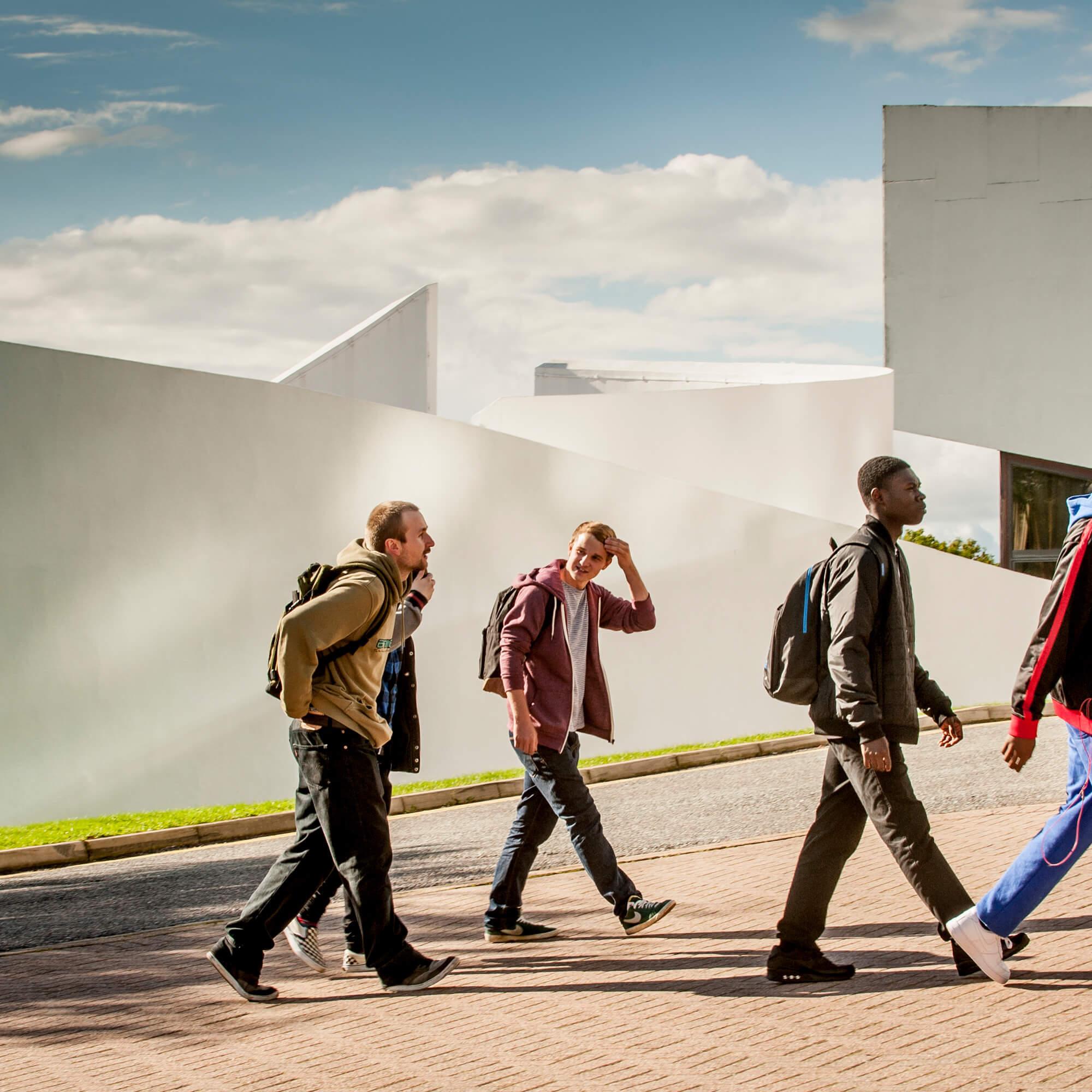 a group of students walking up past the Faith Centre at Kedleston Road