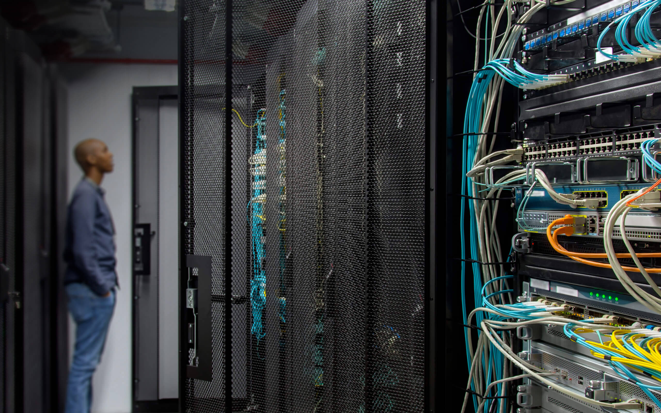 IT Services staff member standing in a Data Centre.