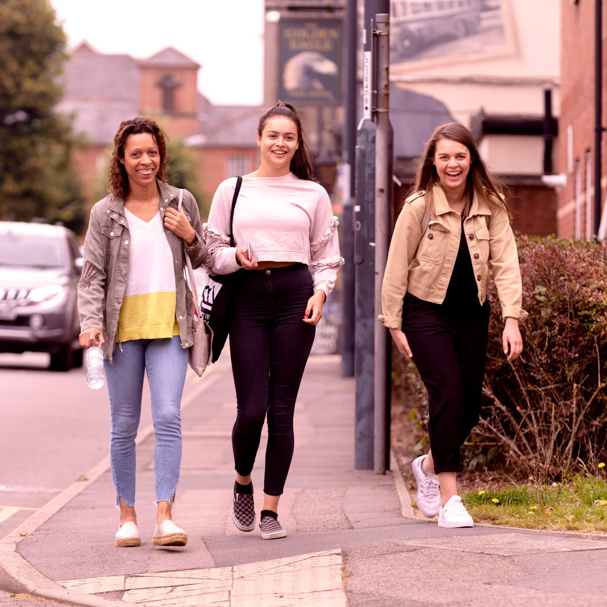 Three students walking through Derby