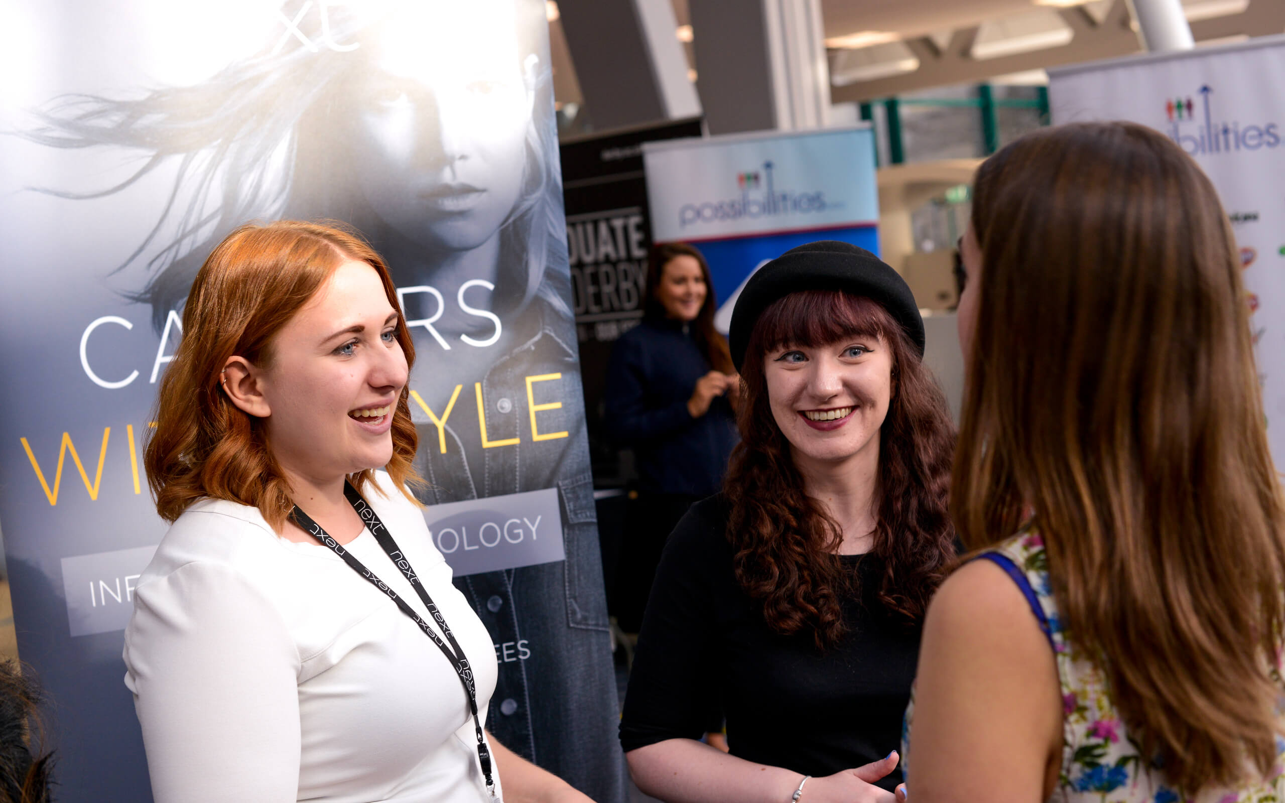 Students talking with employer at careers fair