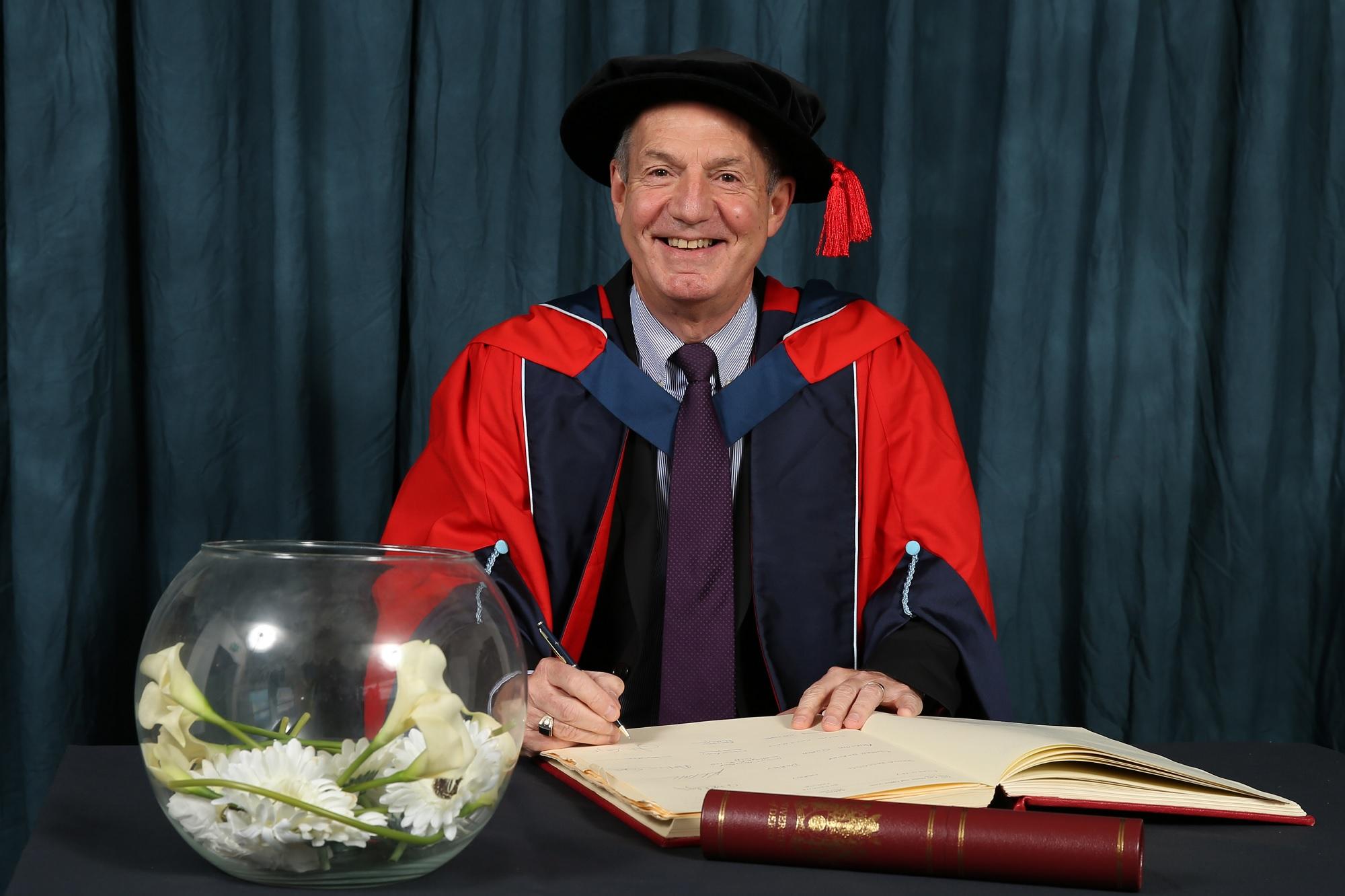 Professor John Coyne CBE receiving his honorary degree, HonDUniv, 2016