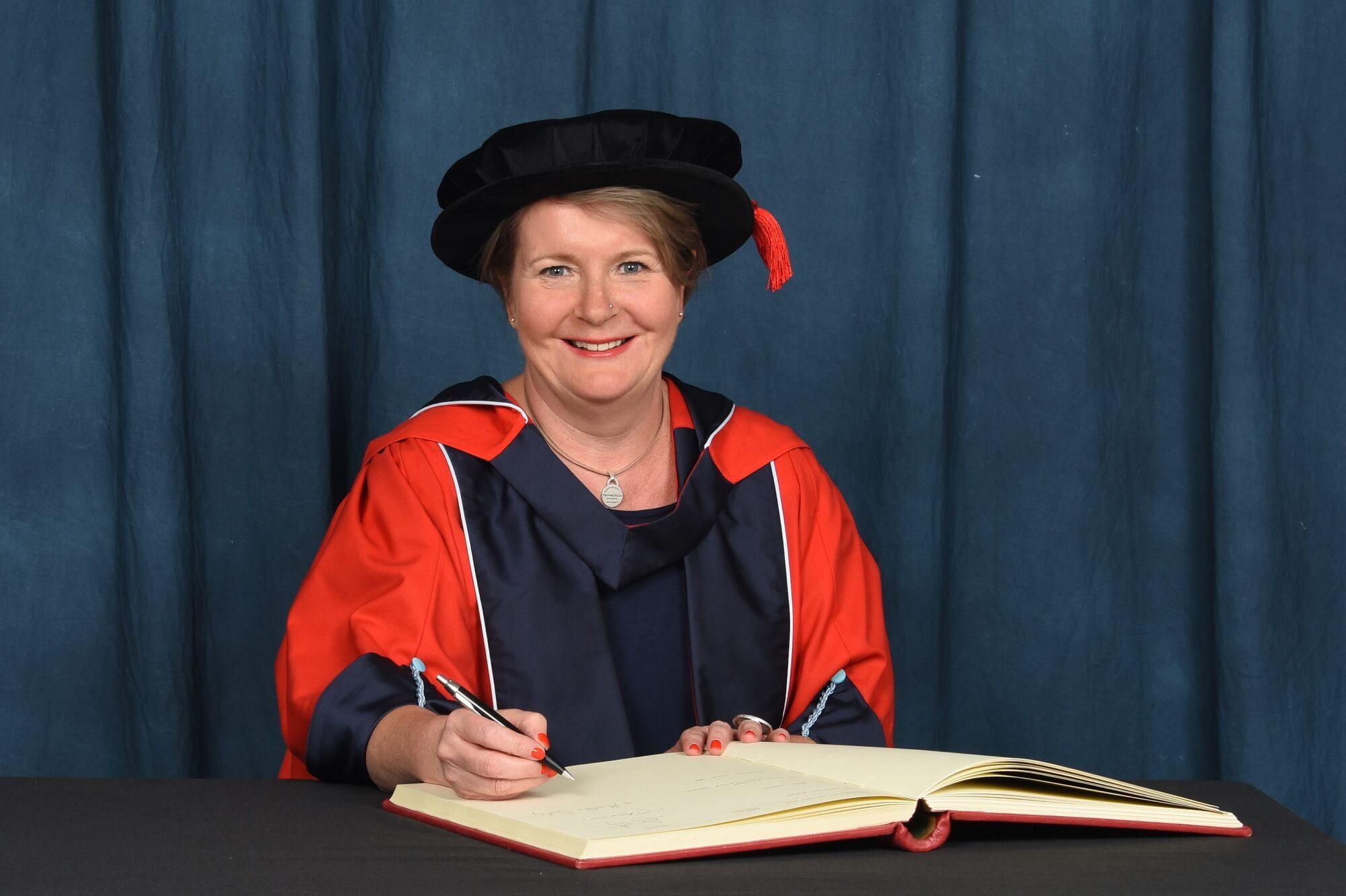 Kathryn Stone OBE receiving her honorary degree (HonLLD)