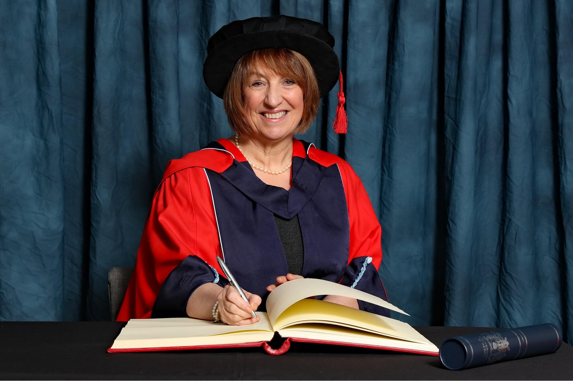 Kay Fawcett OBE receiving her honorary degree (HonDUniv)