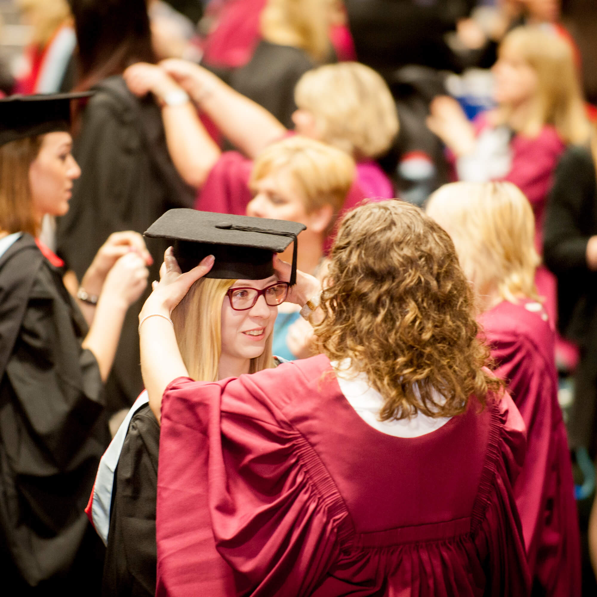 A student is gowned for graduation