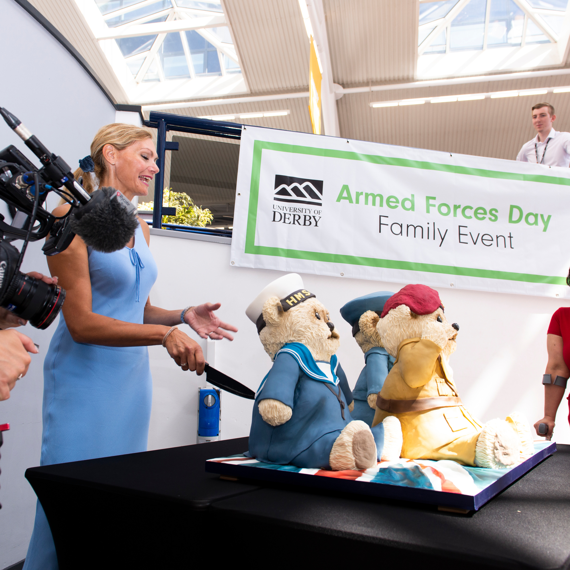 Paula Holt talking in from of a crowd on armed forces day.