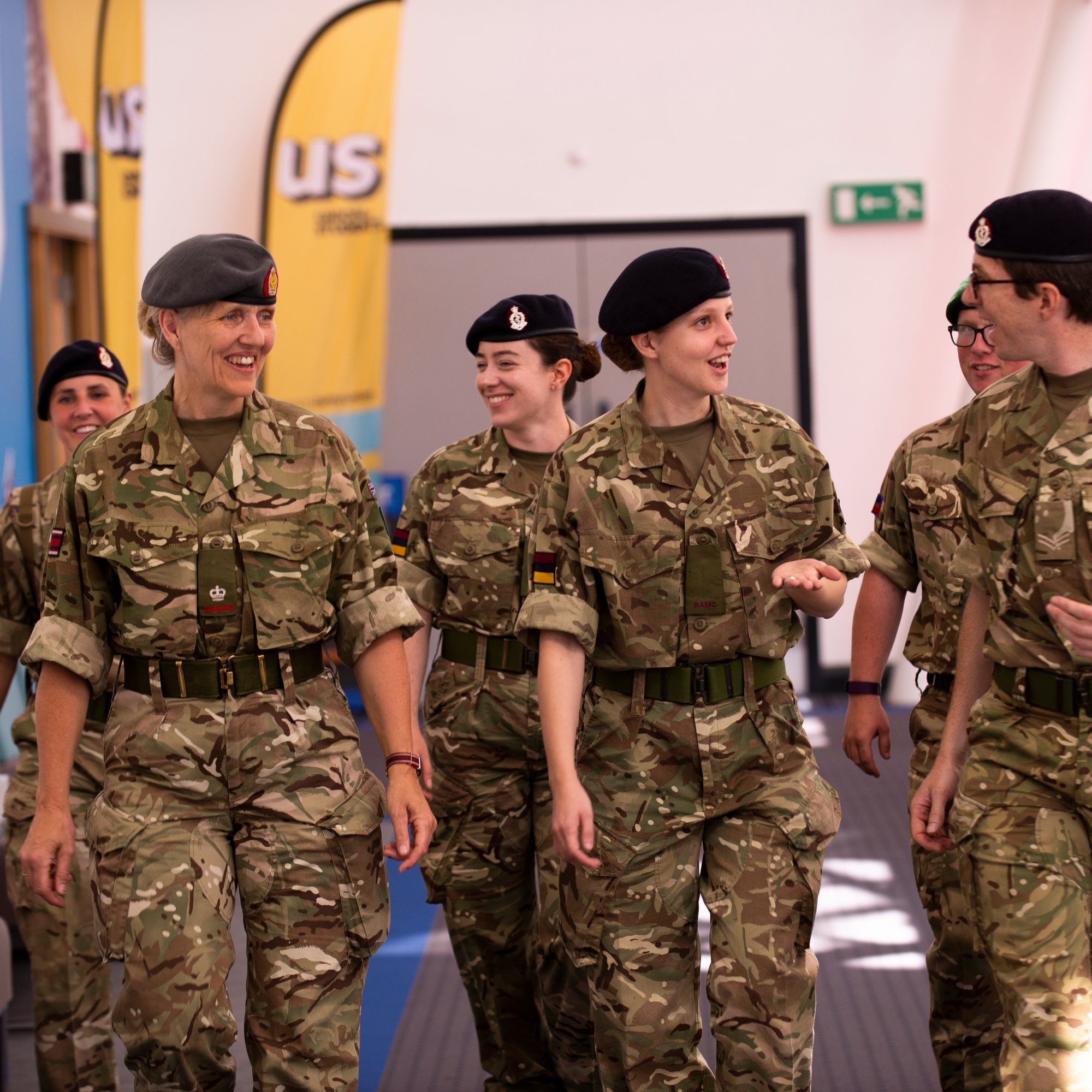Six people from the army working through the University's atrium.