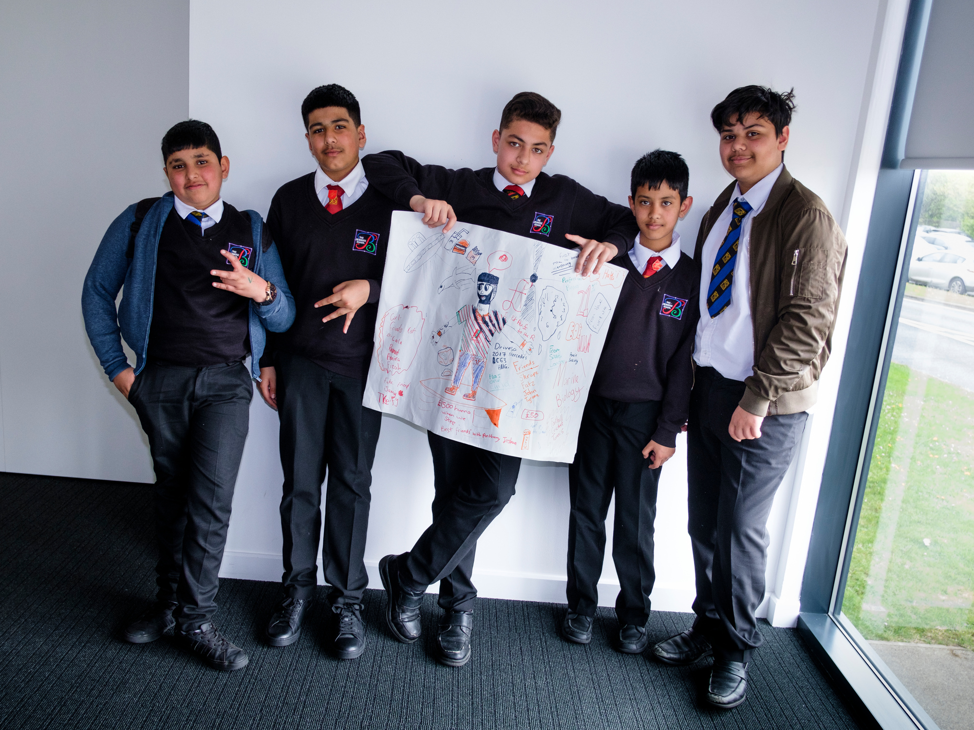 Five students presenting their work on a Year 7 Experience Day at the University.