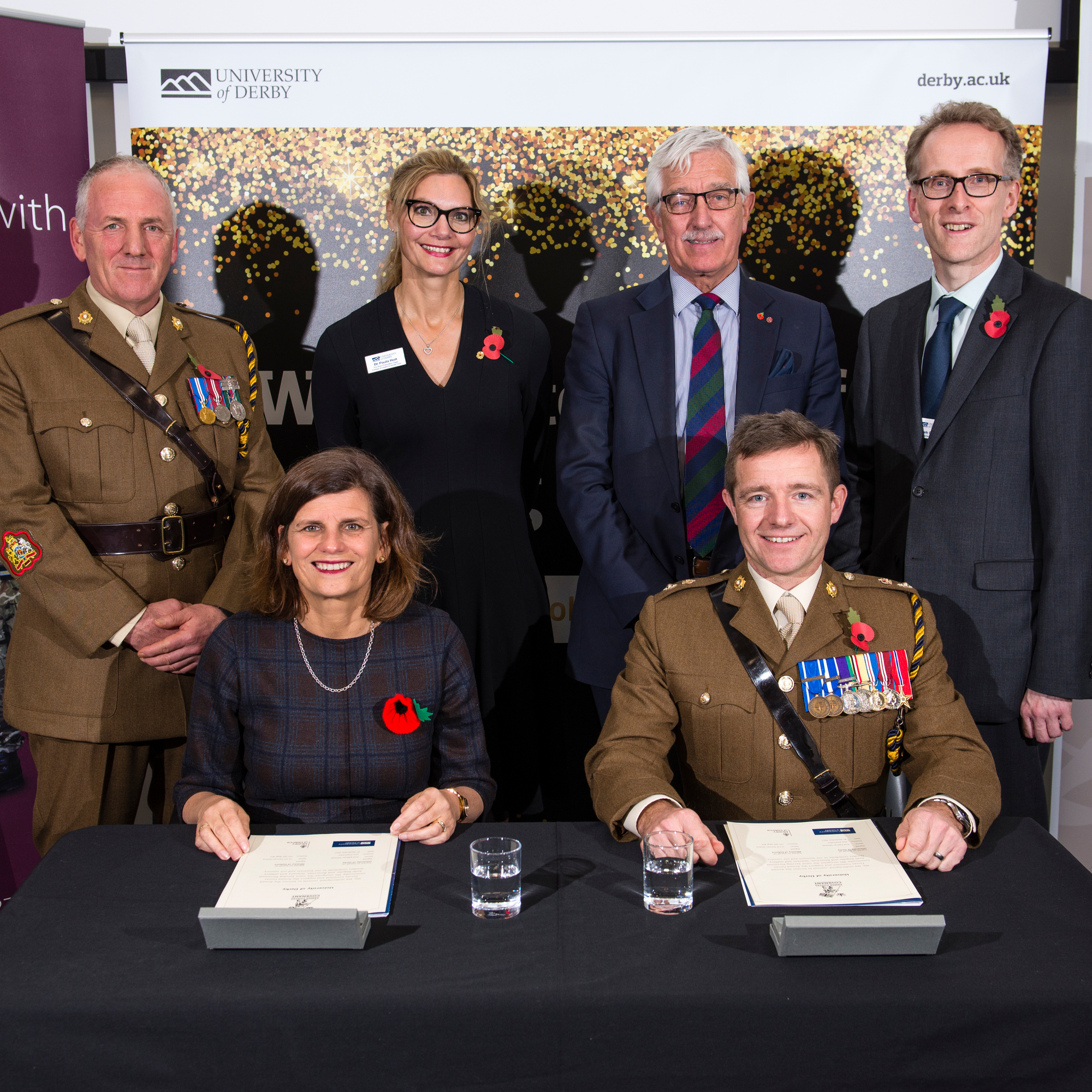 6 people signing The Armed Forces Covenant.