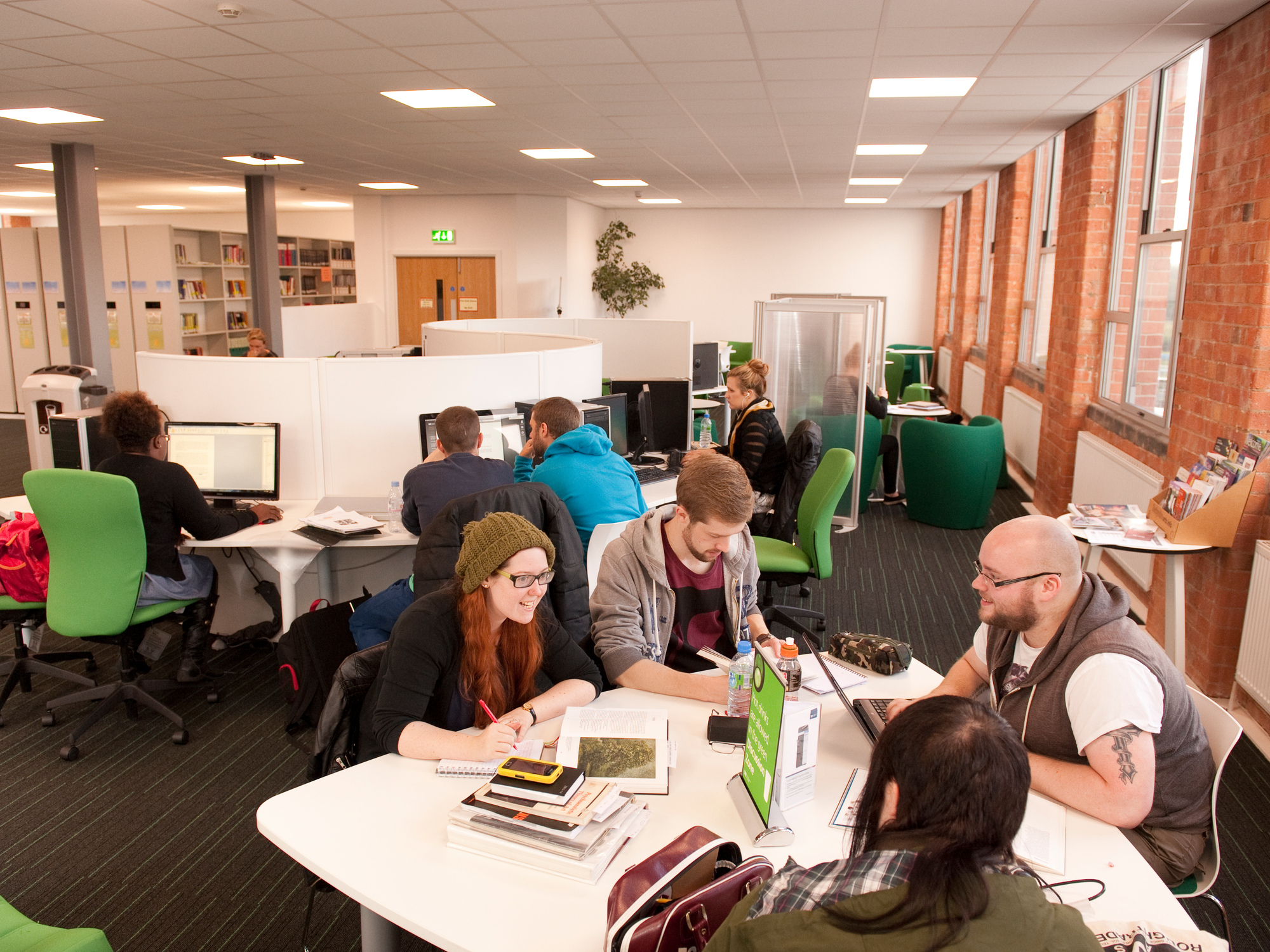 Students sat round a table together in the library.