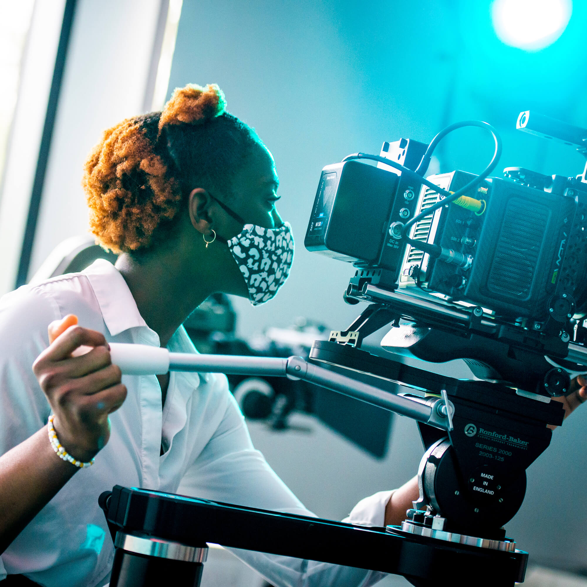 A student with a camera filming.