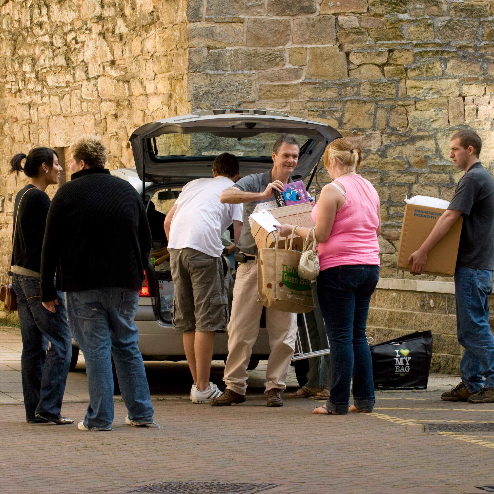 Family members helping a student unpack a car ready to move into halls of residence