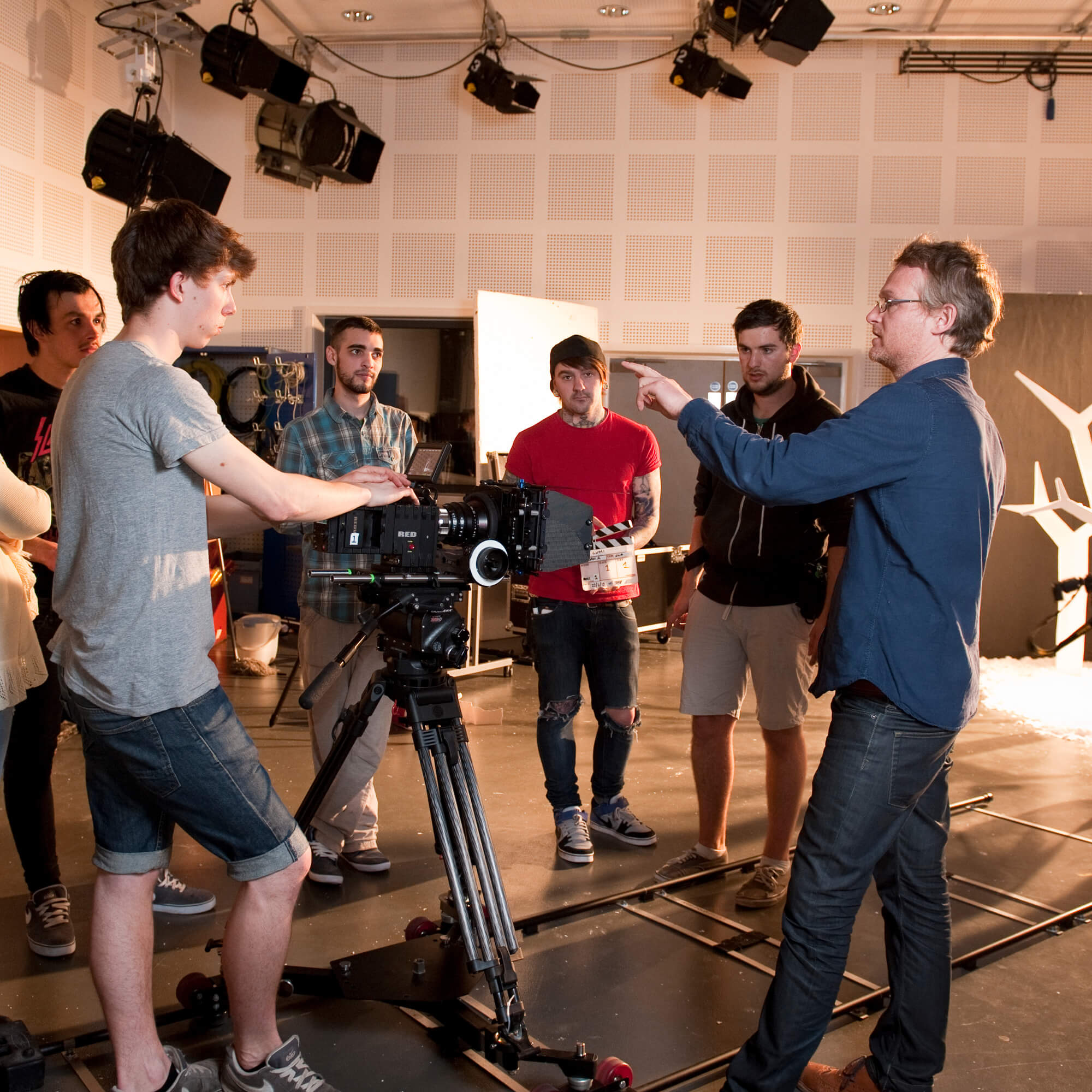 Students working with a video camera in the Film and Television studios