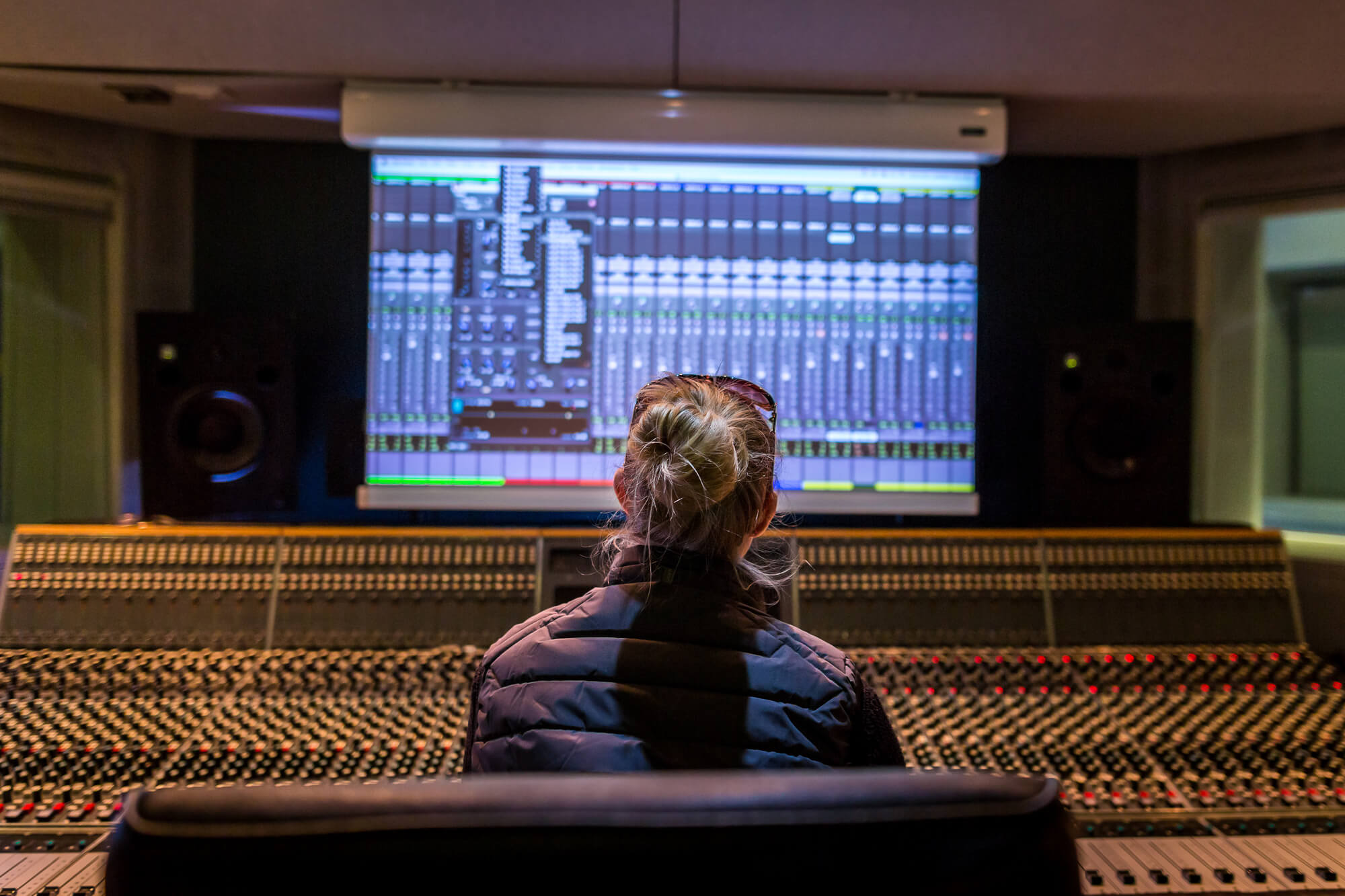 Student sat in music production control room