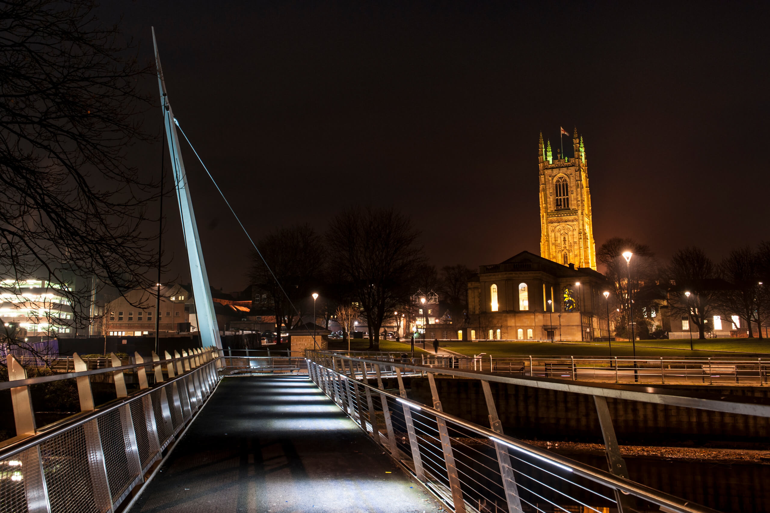 Nighttime view of Derby from the Cathedral Green footbridge