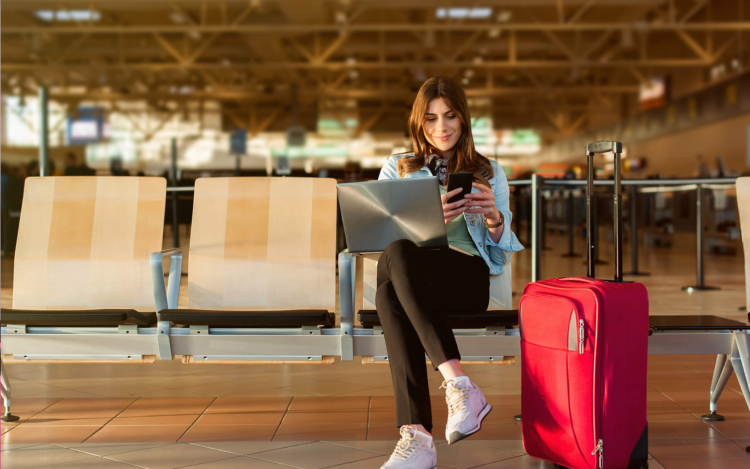 Female student waiting in airport