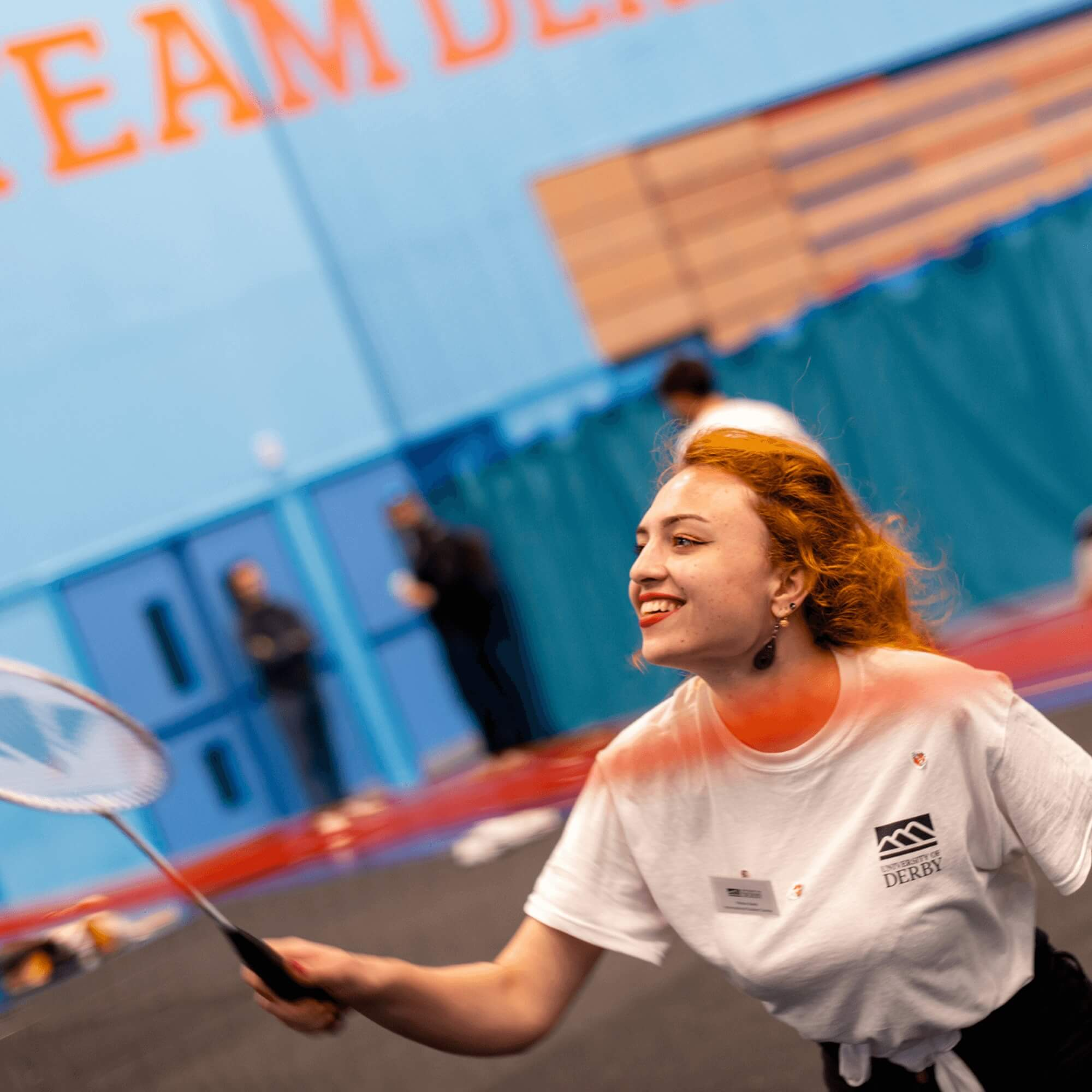 An international student playing badminton