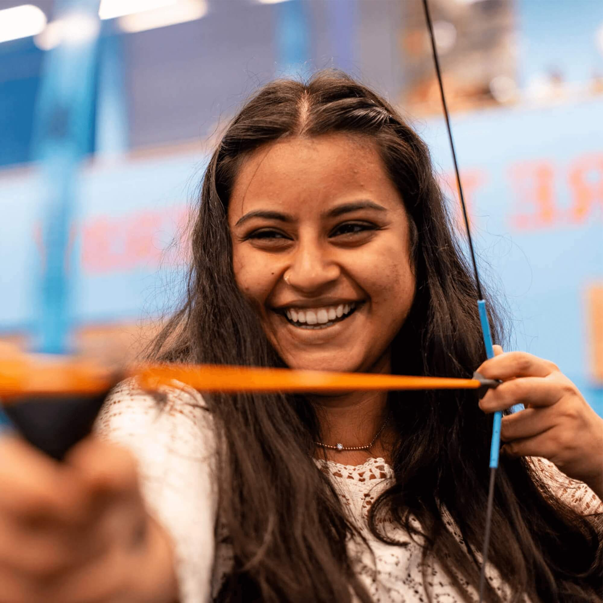 A young international student from India having a go at archery