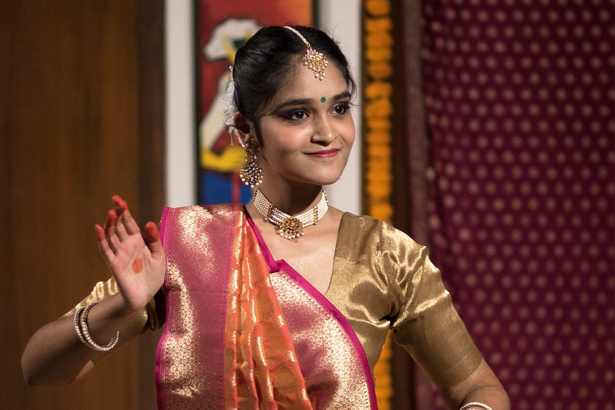 A student performing Indian Classical Dance