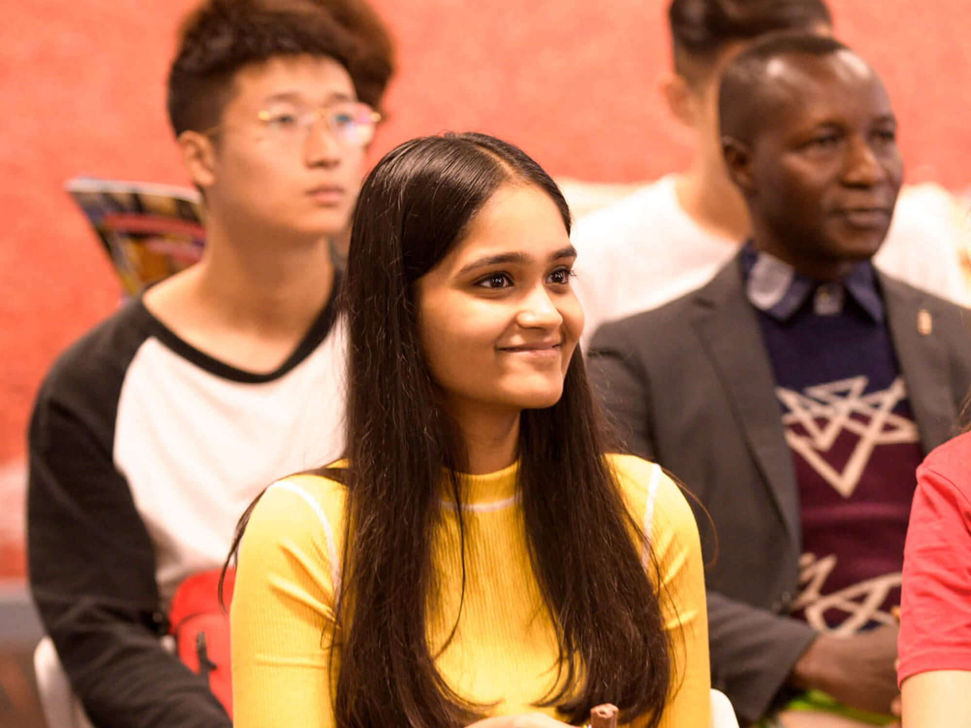 Mohika Shankar sits in a classroom