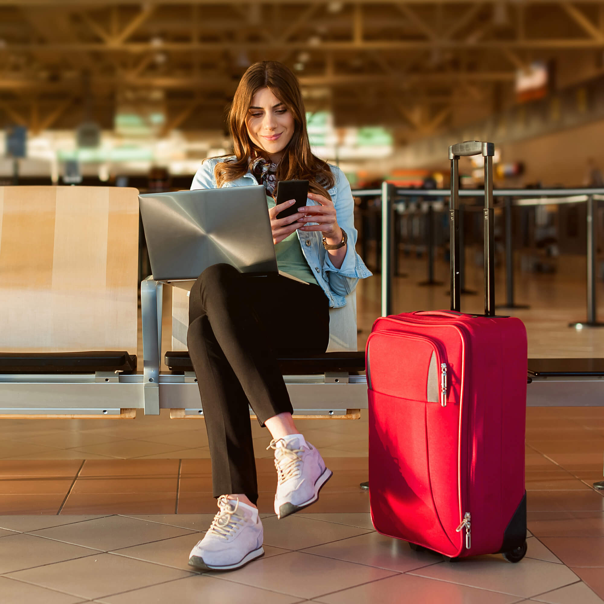 Girl on phone, waiting in airport