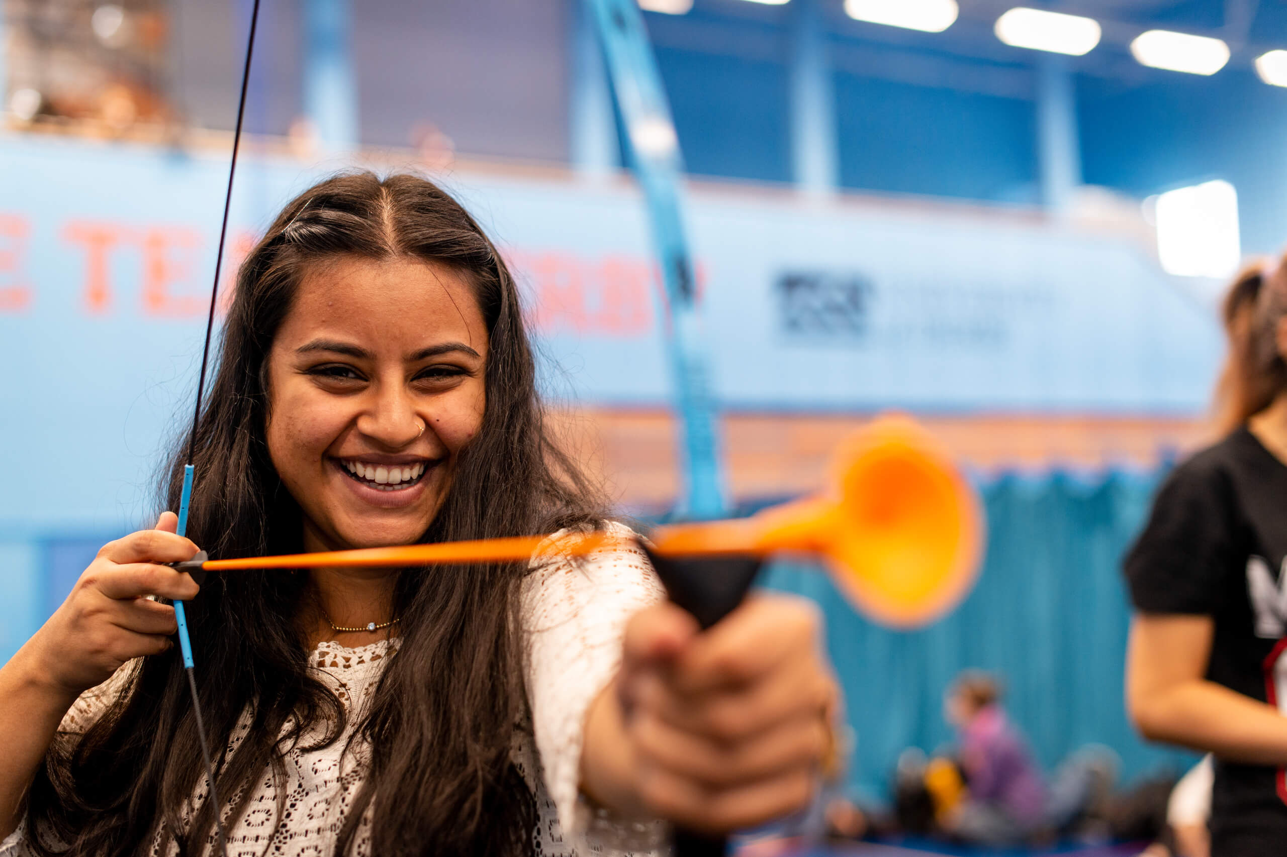 International student in the Sport centre at the Derby Campus taking part in the welcome week activities