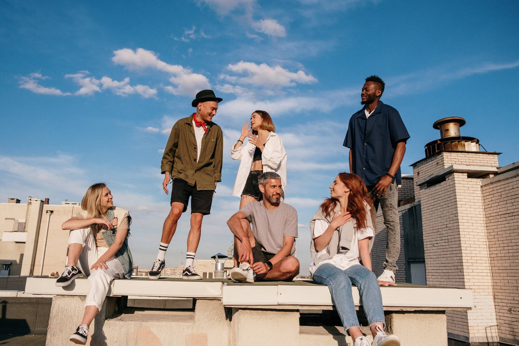 Group of people standing on top of a building