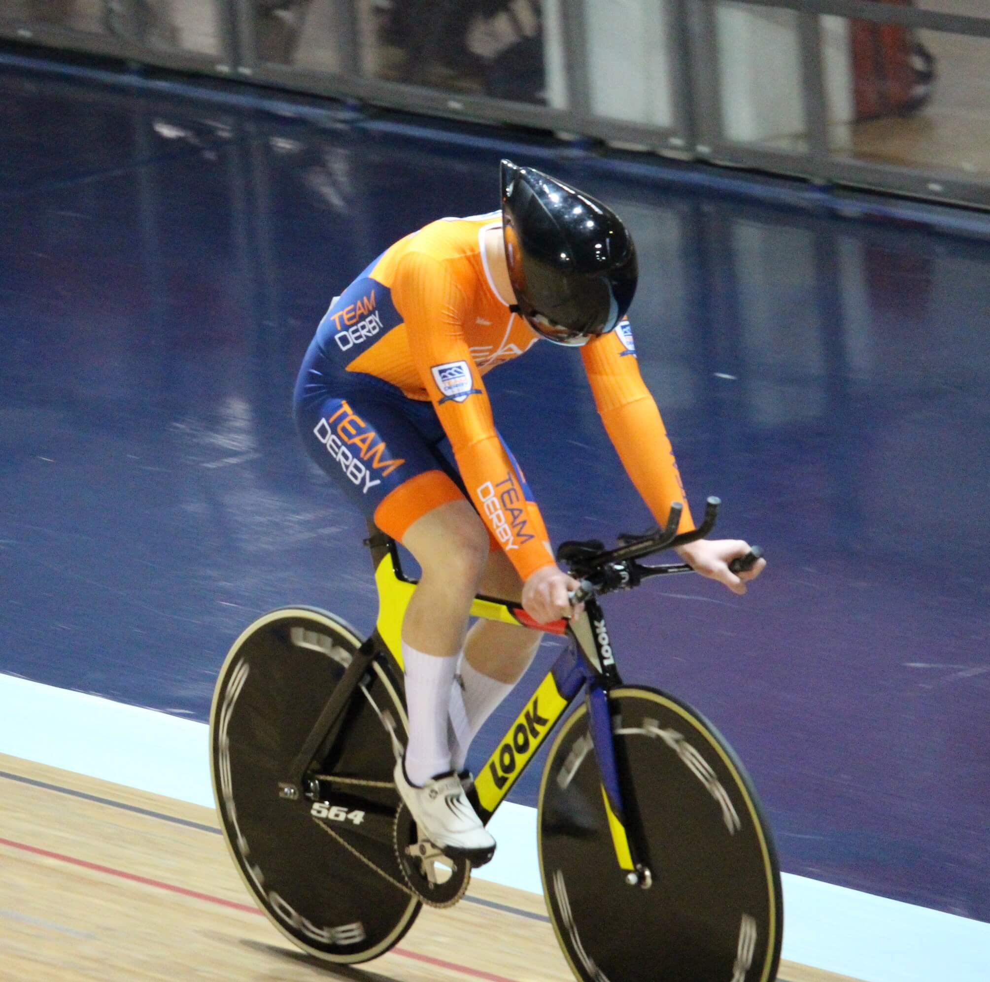 Team Derby sports student cycling on Indoor velodrome track