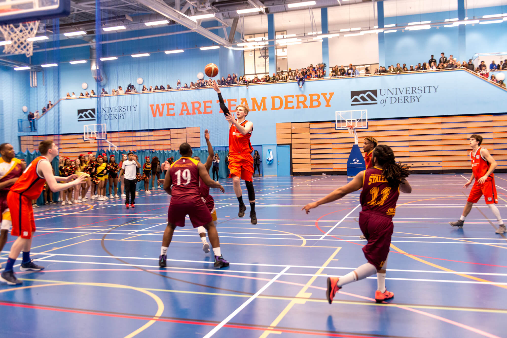 Men's basketball playing in the sports hall for Varsity 2018