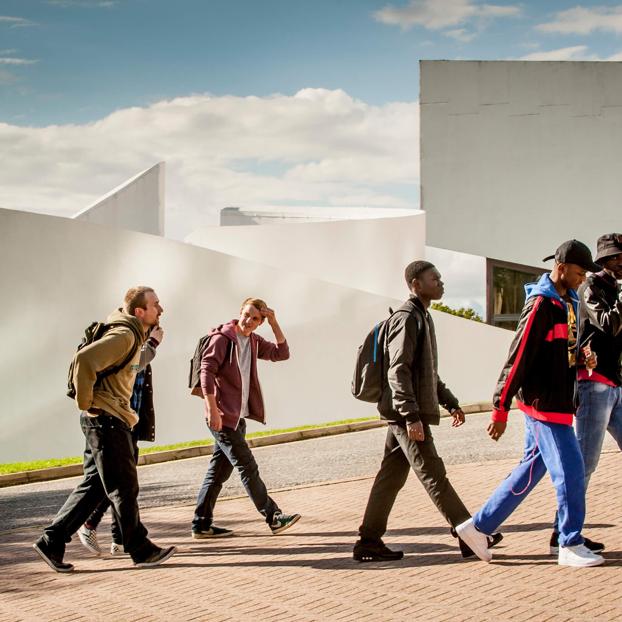 Students walking towards the University's main entrance