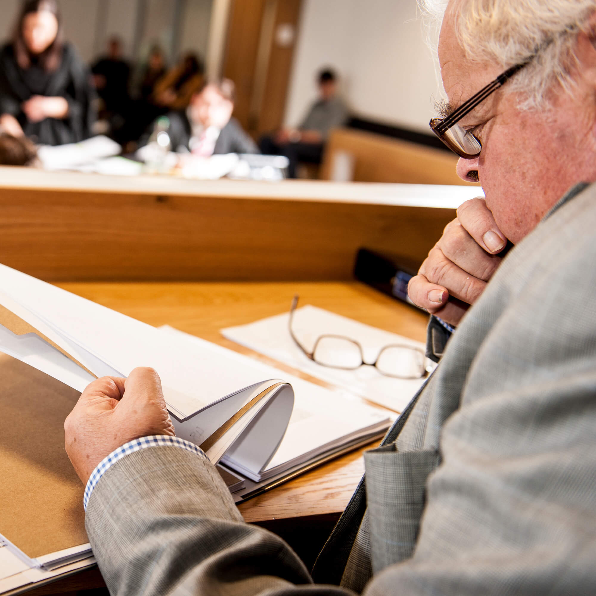 Man reading documents at University Moot competition