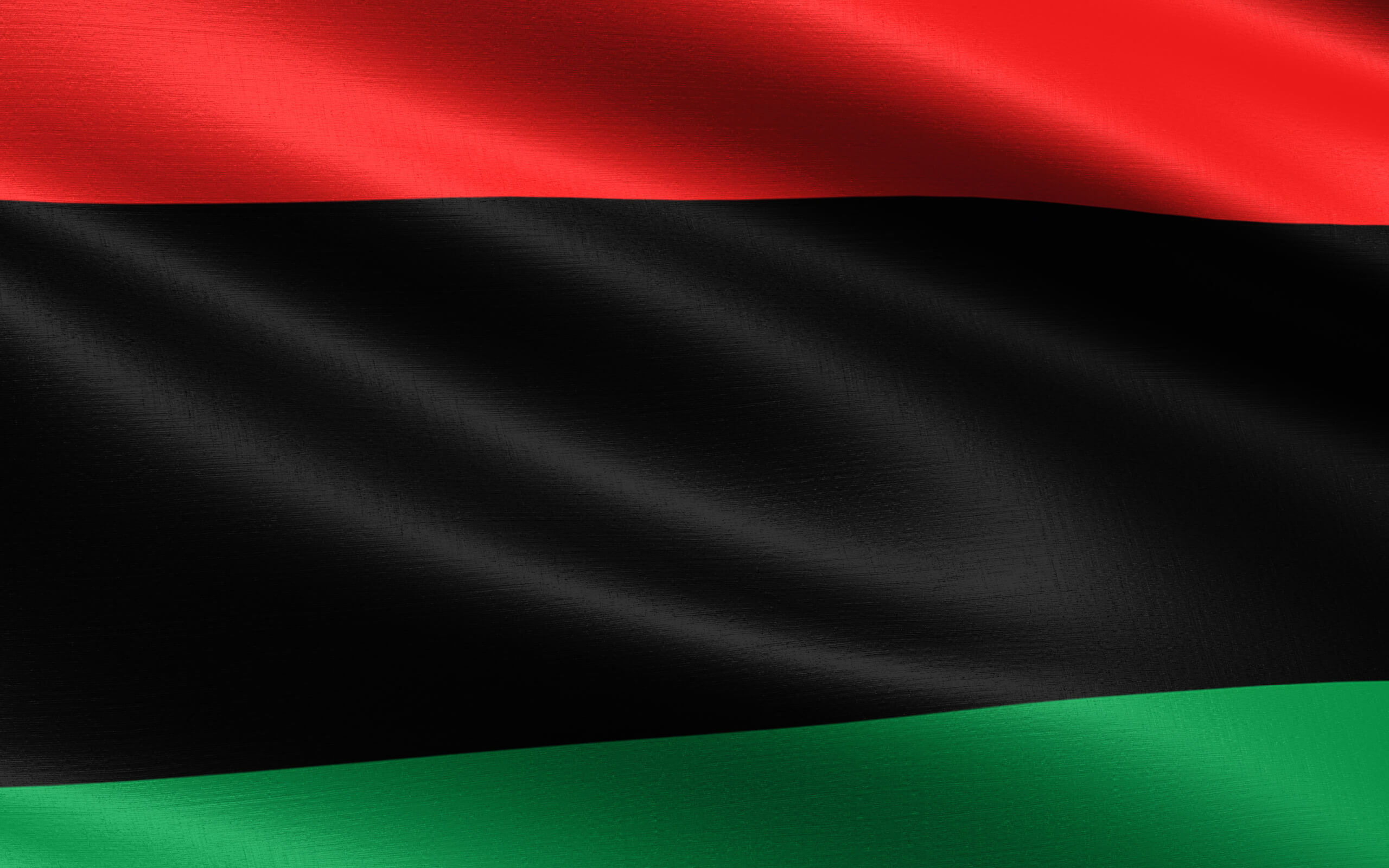 red, black and green black history month flag