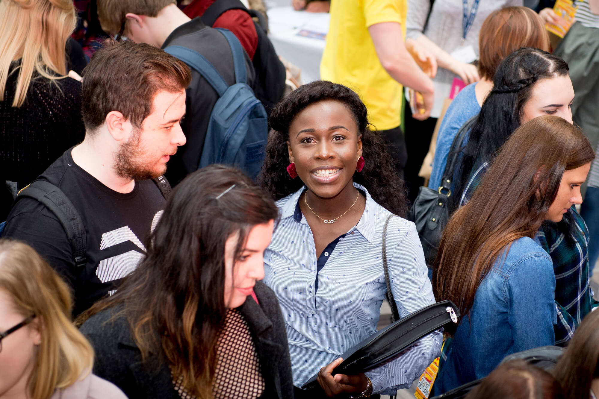 happy BAME student in the University of Derby atrium at a Freshers event