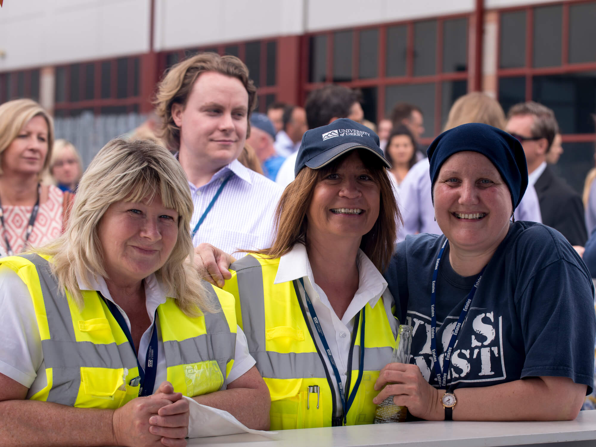 smiling members of staff at a University event
