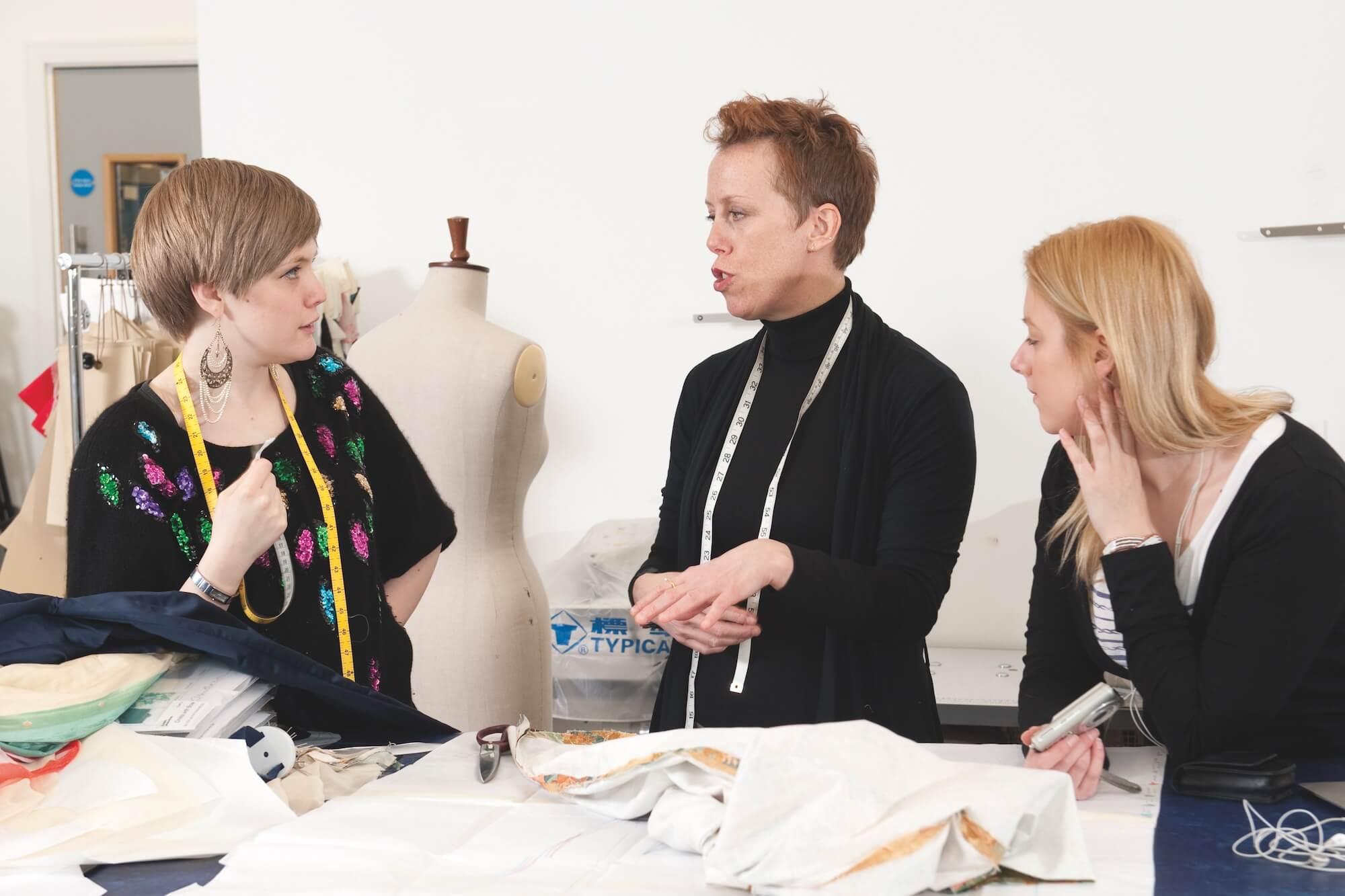 Fashion academics having a team briefing