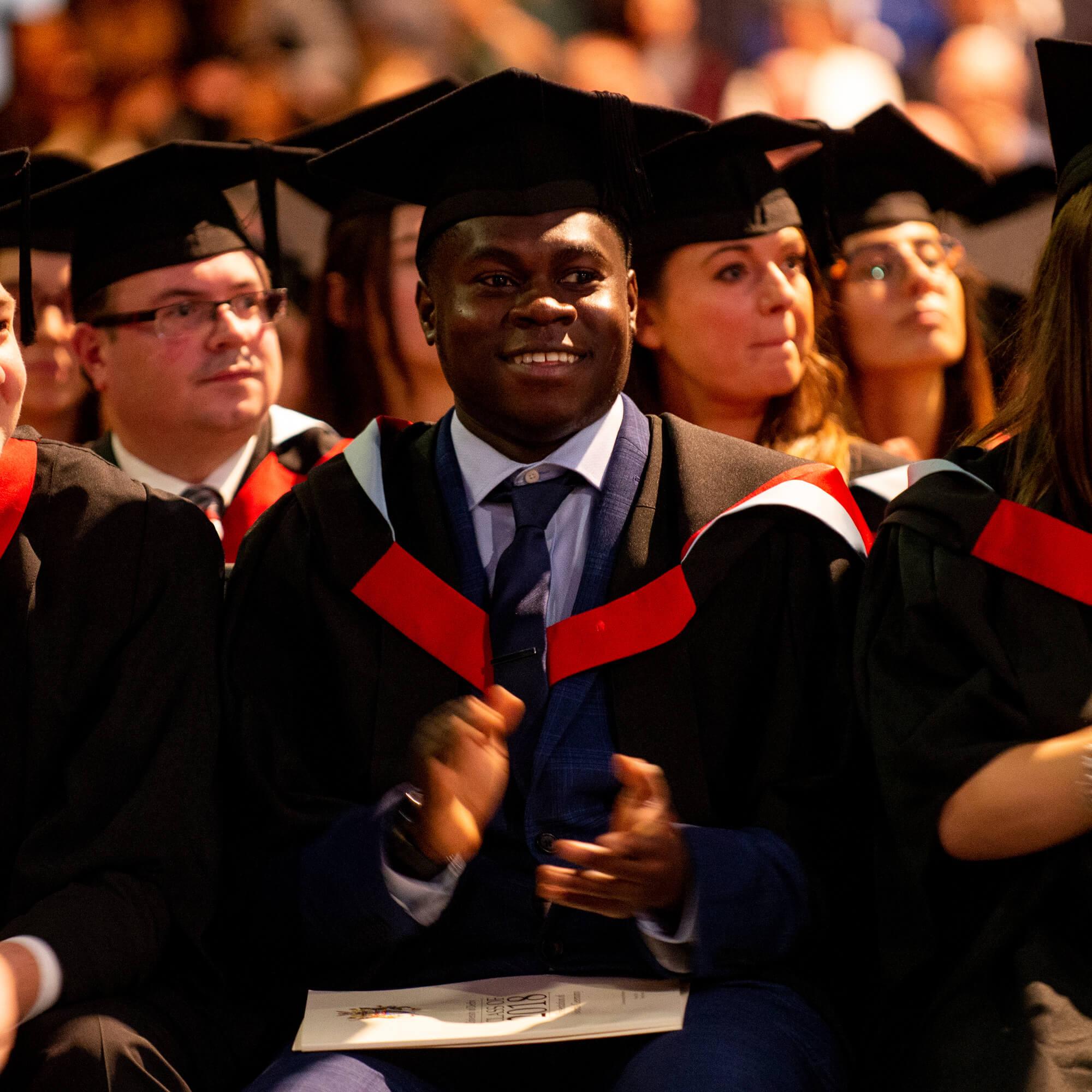 students applauding at graduation