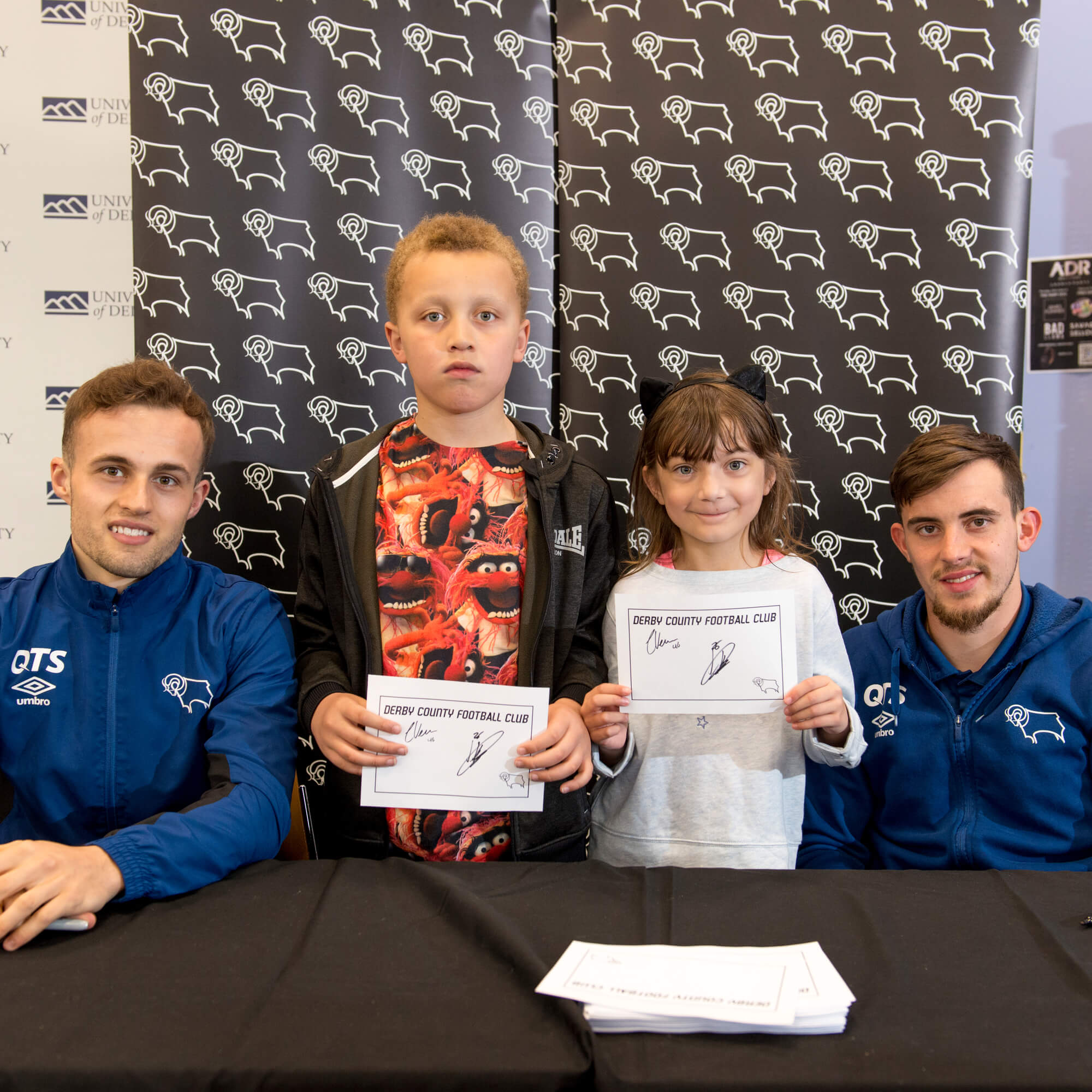 Youngsters with Derby County footballers at a Community Day