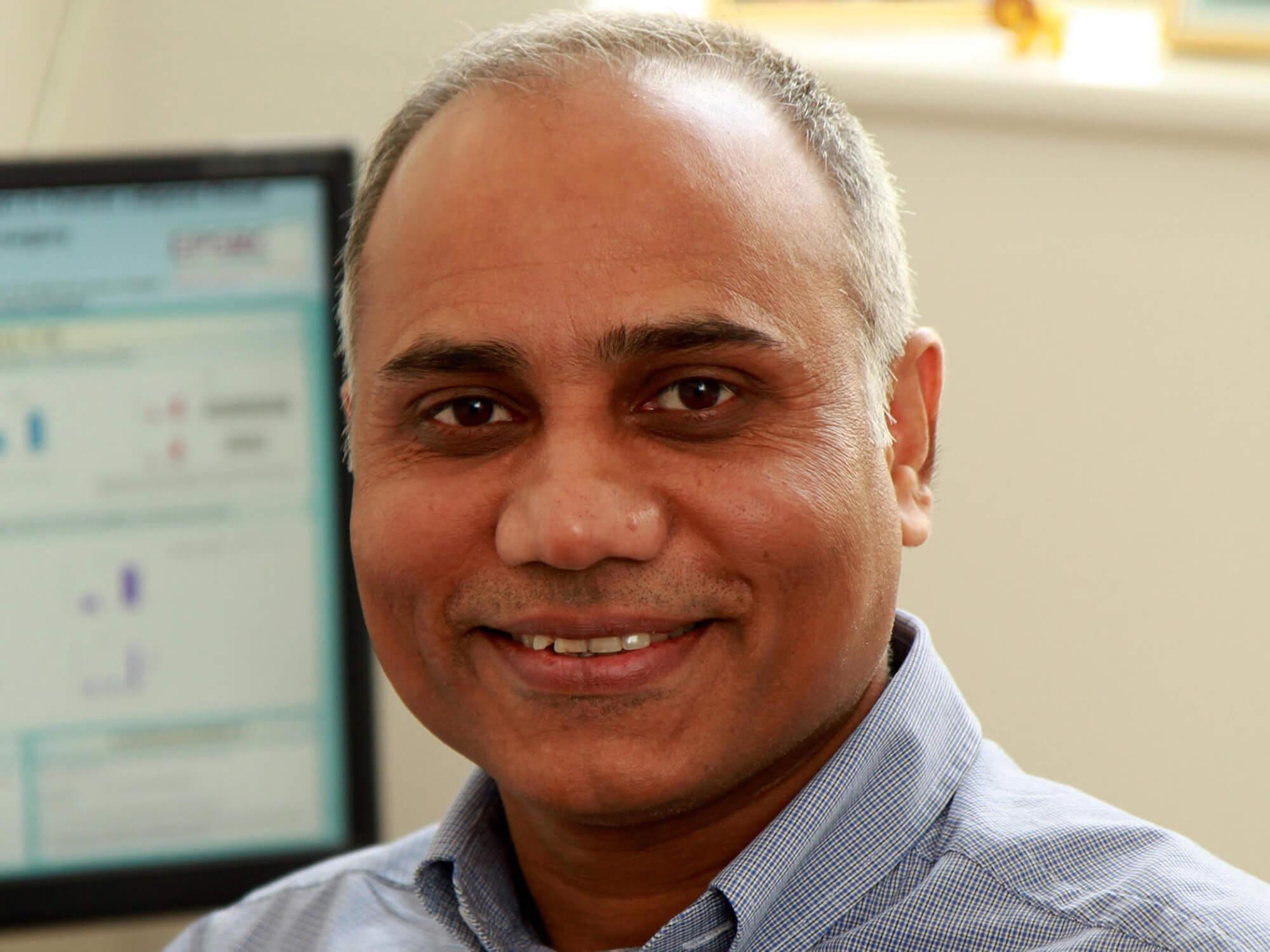 Gyan Tripathi smiling